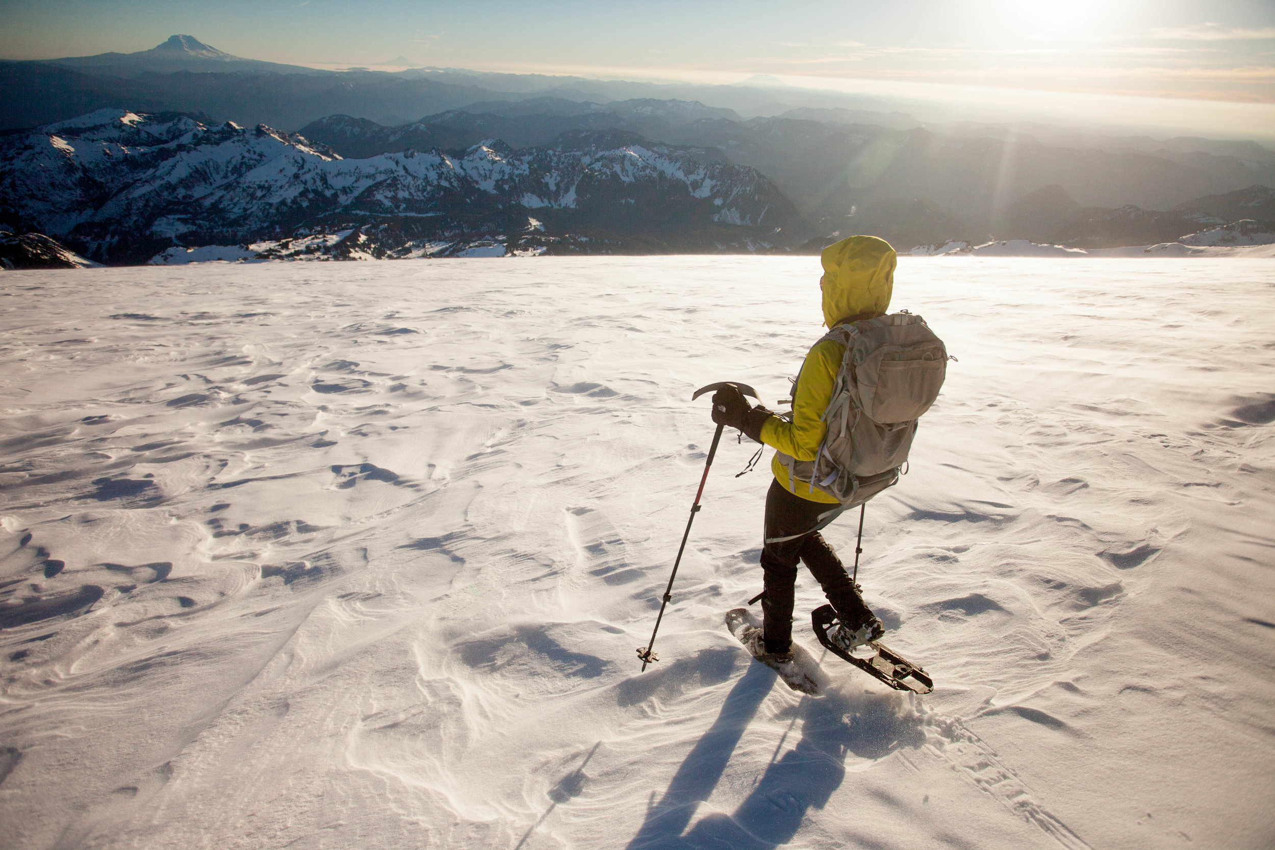 Descending Muir Snowfield, with Mt. Adams in the distance
