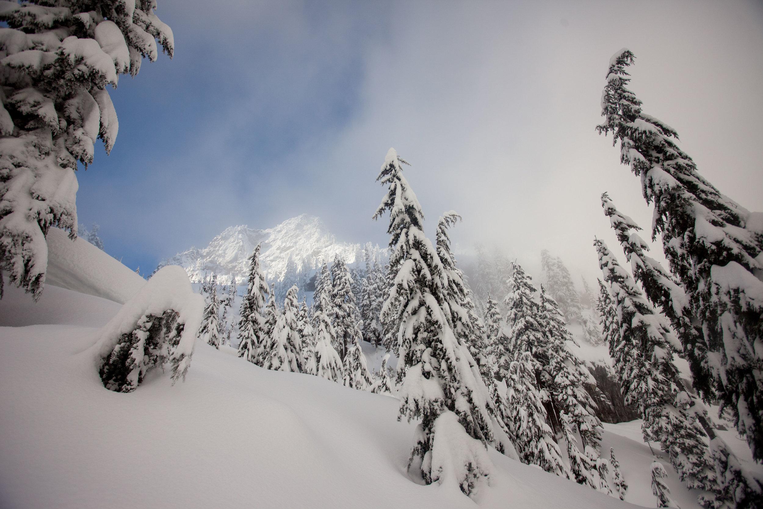 Bryant Peak shines through the clouds