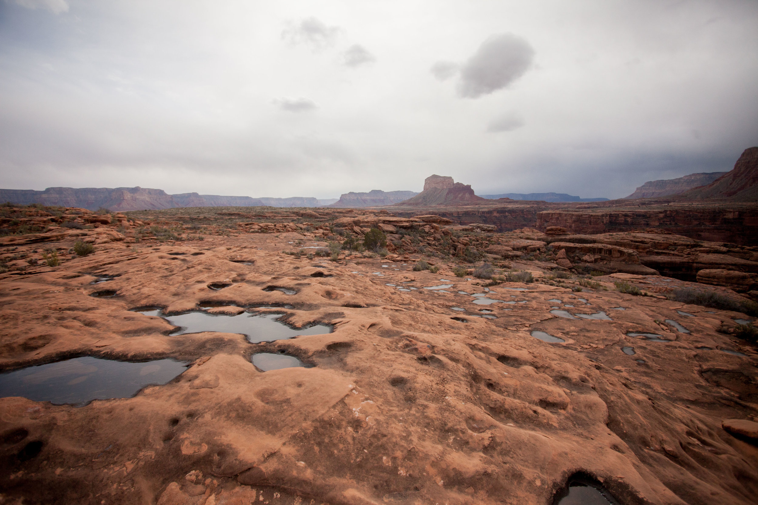 Perched on top of the Esplanade, watching storms roll in as we tried to decide if we should drop into a slot canyon.