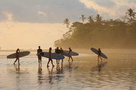 Surfers on the Pacific coast