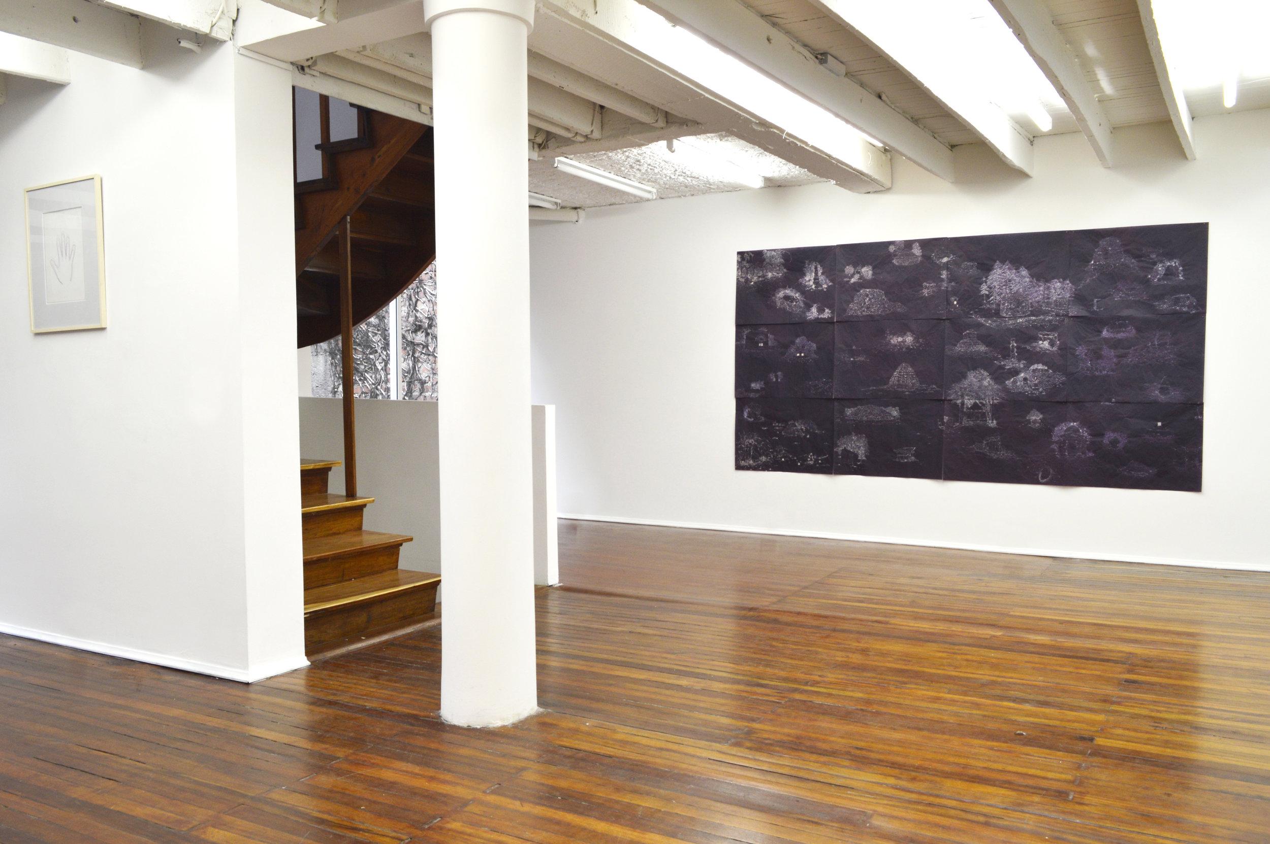 """A CONTRALUZ, 2014  Exhibición individual, vista de sala segundo piso.  """"Los ombligos del mundo""""   Hipoclorito de sodio sobre papel de seda   150 x 280 cm   2013"""