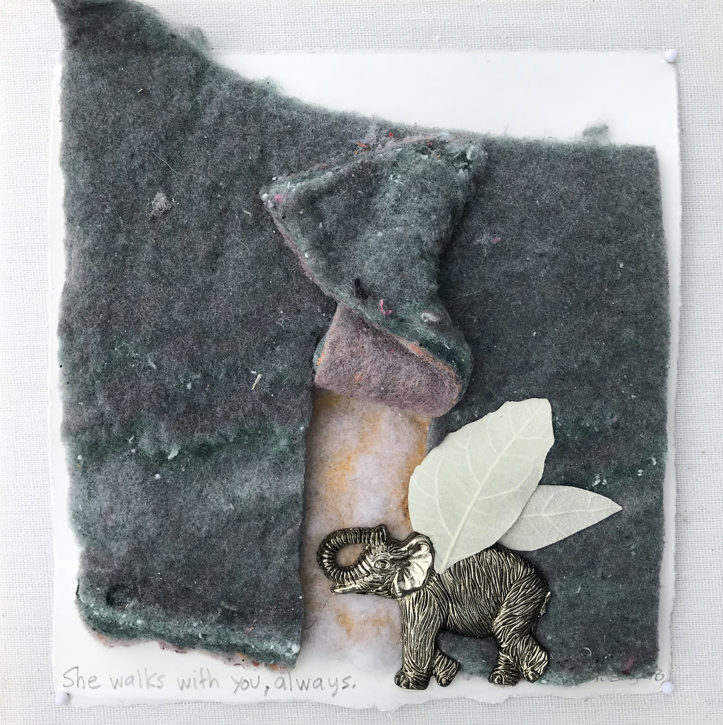 She walks with you, always. - 2018  laundry lint, white poplar leaves, metallic elephant on cotton rag paper