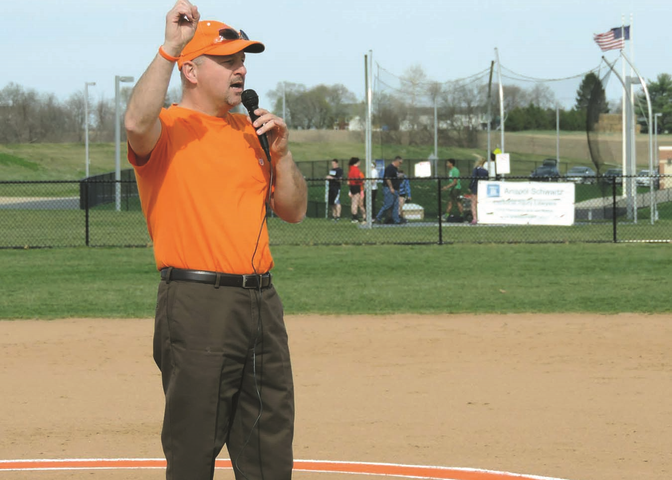 Mark Brezitski speaks about Owen's Foundation at a local softball game in Owen's honor.