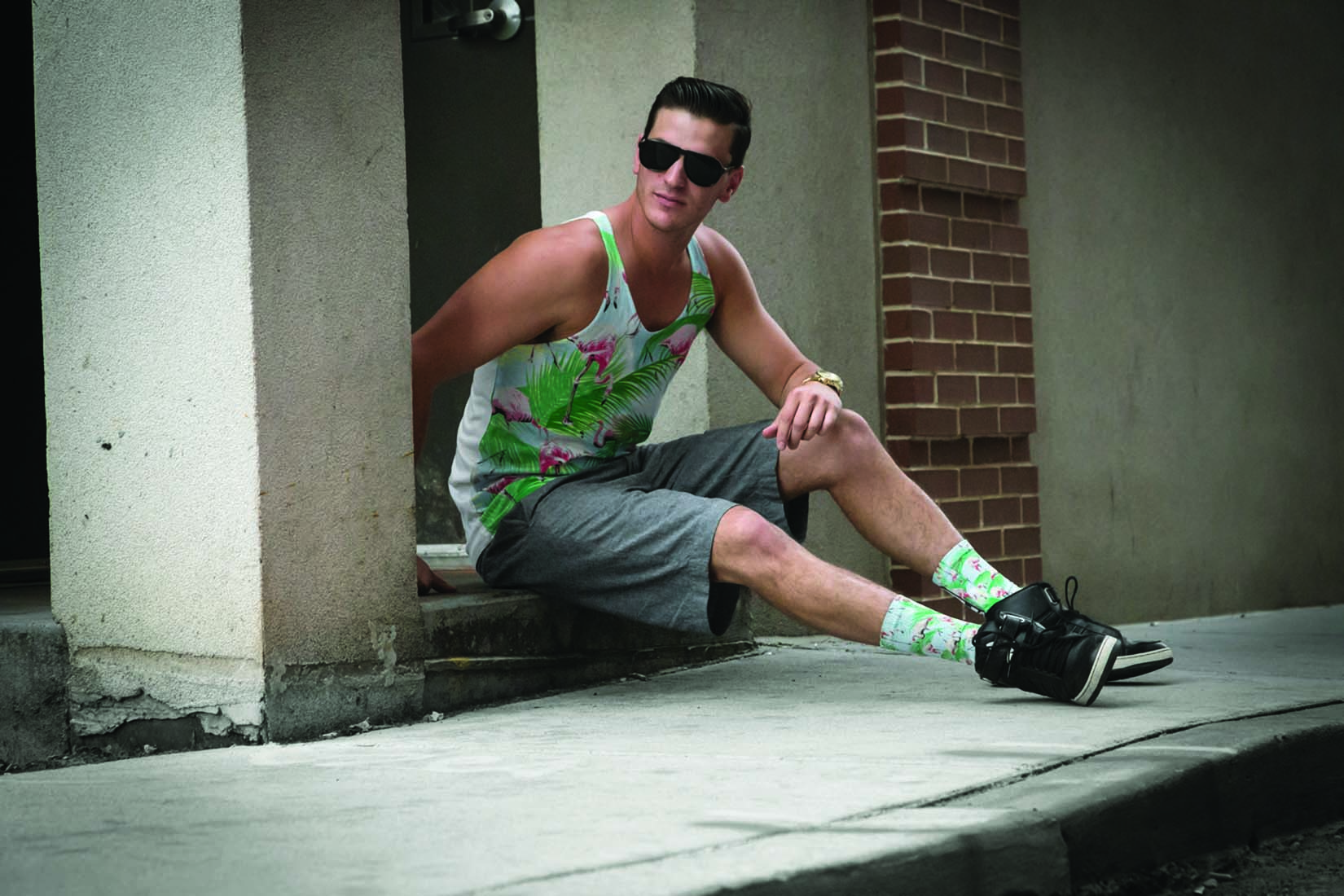 Adam Sinz '13, designer and founder of Amped Apparel, models his products.