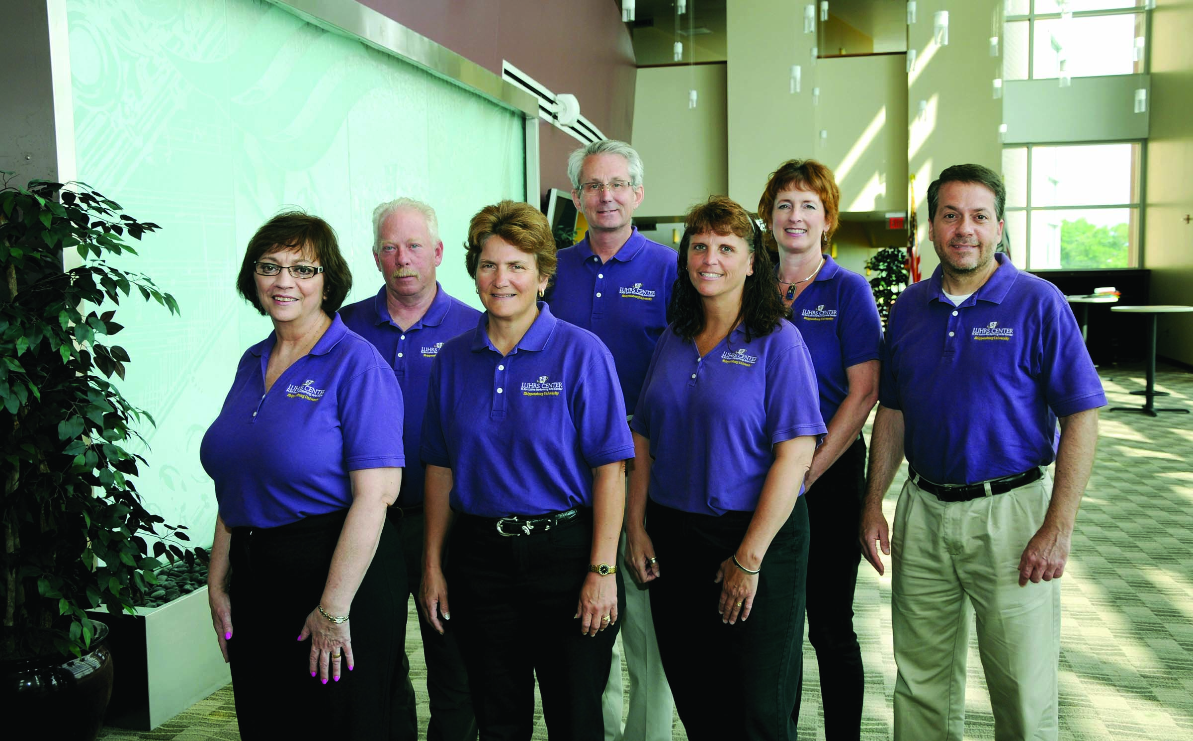Luhrs Peforming Arts Center staff members (from left) are Deb Taylor, front of house manager; Daniel Stine, assistant technical services director; Leslie Folmer Clinton '82, director; Robert Shirk, technical services director; Jill Heberlig, administrative assistant; Robin Dolbin '06M, ticket services and sales manager; and Mark Bodenhorn '84, director of marketing and administrative services.