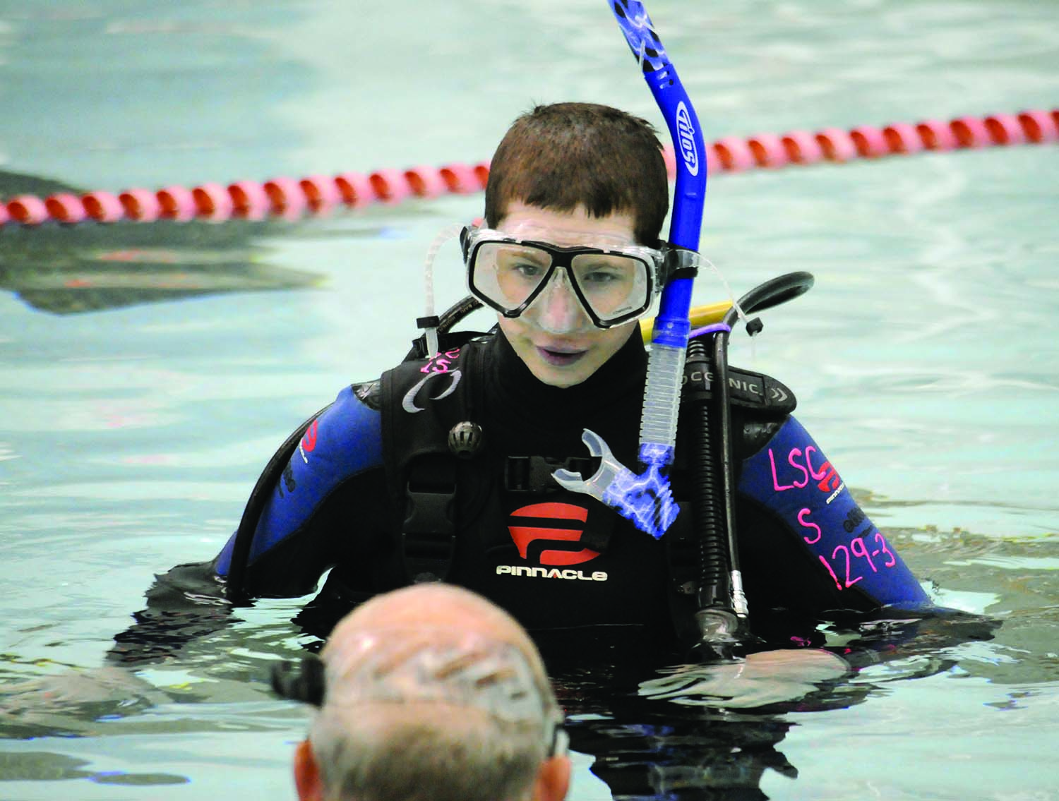 Seth, a student at Yellow Breeches, receives instruction from Dr. Chris Schwilk during a pool dive in Heiges Field House as part of his scuba certification.