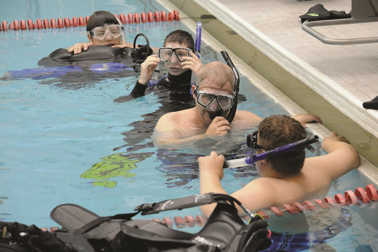 Dr. Chris Schwilk works with students from Yellow Breeches to complete their scuba certification before applying their new skills during ocean dives off the coast of Florida.