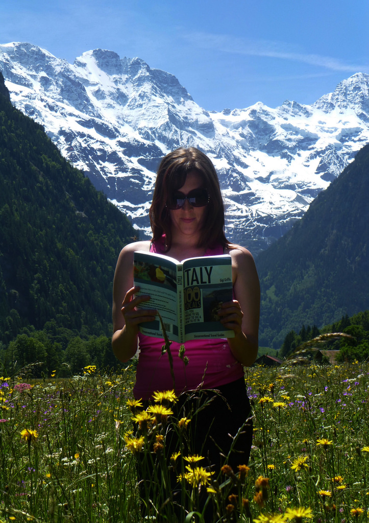 Griffis flips through her first published book in the Swiss Alps.