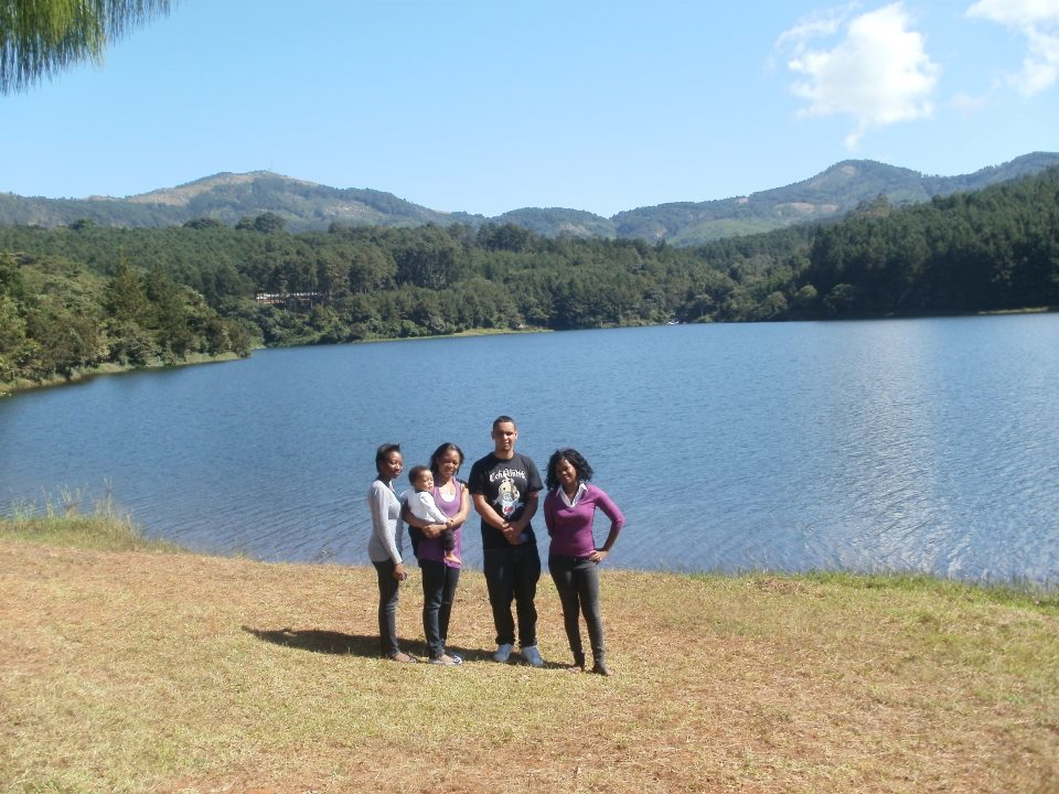 Gabby Gomani (right) with family at their lake in Malawi.