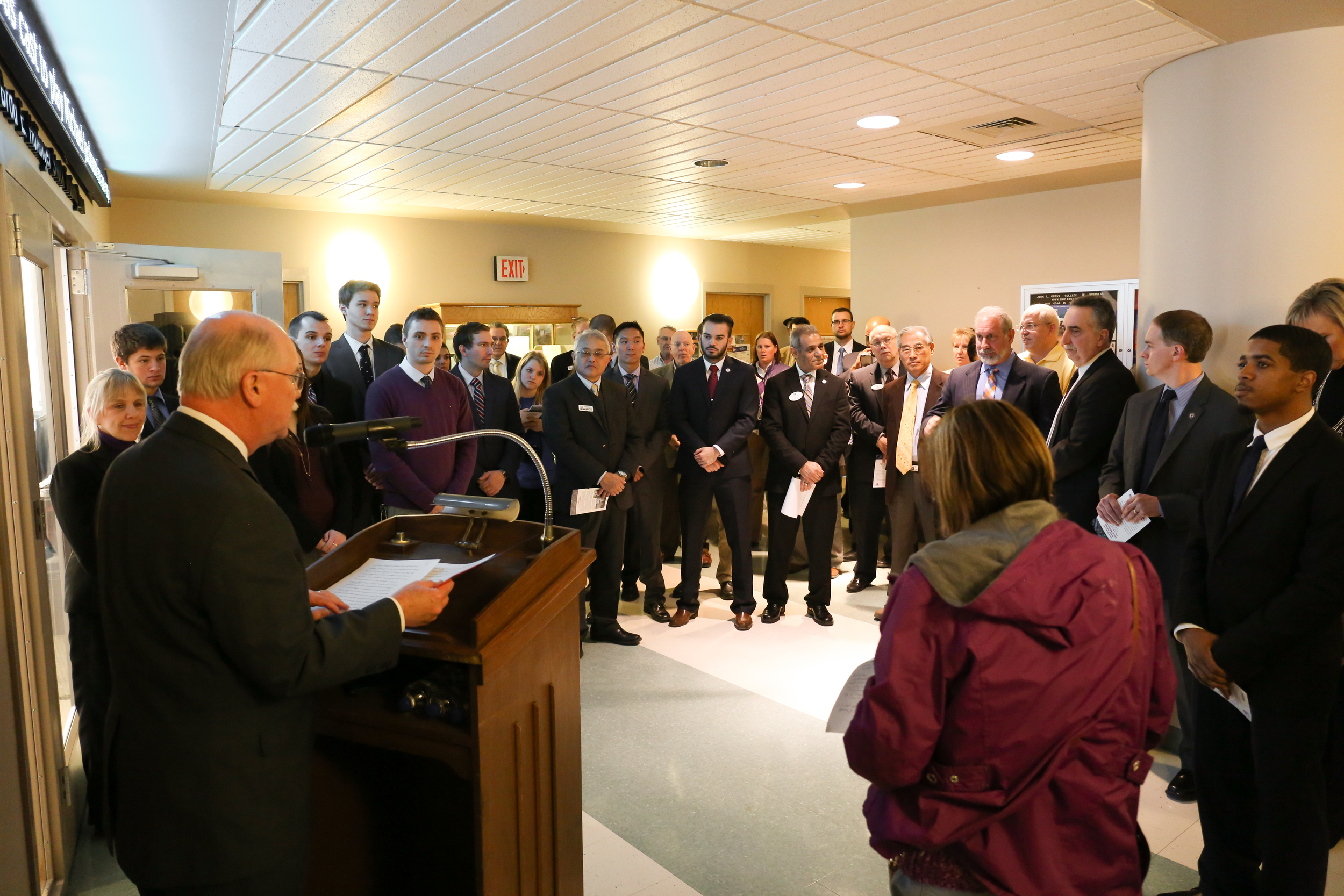 Dr. Jody Harpster '74M, president, speaks at the dedication of the new stock trading room in Grove College.