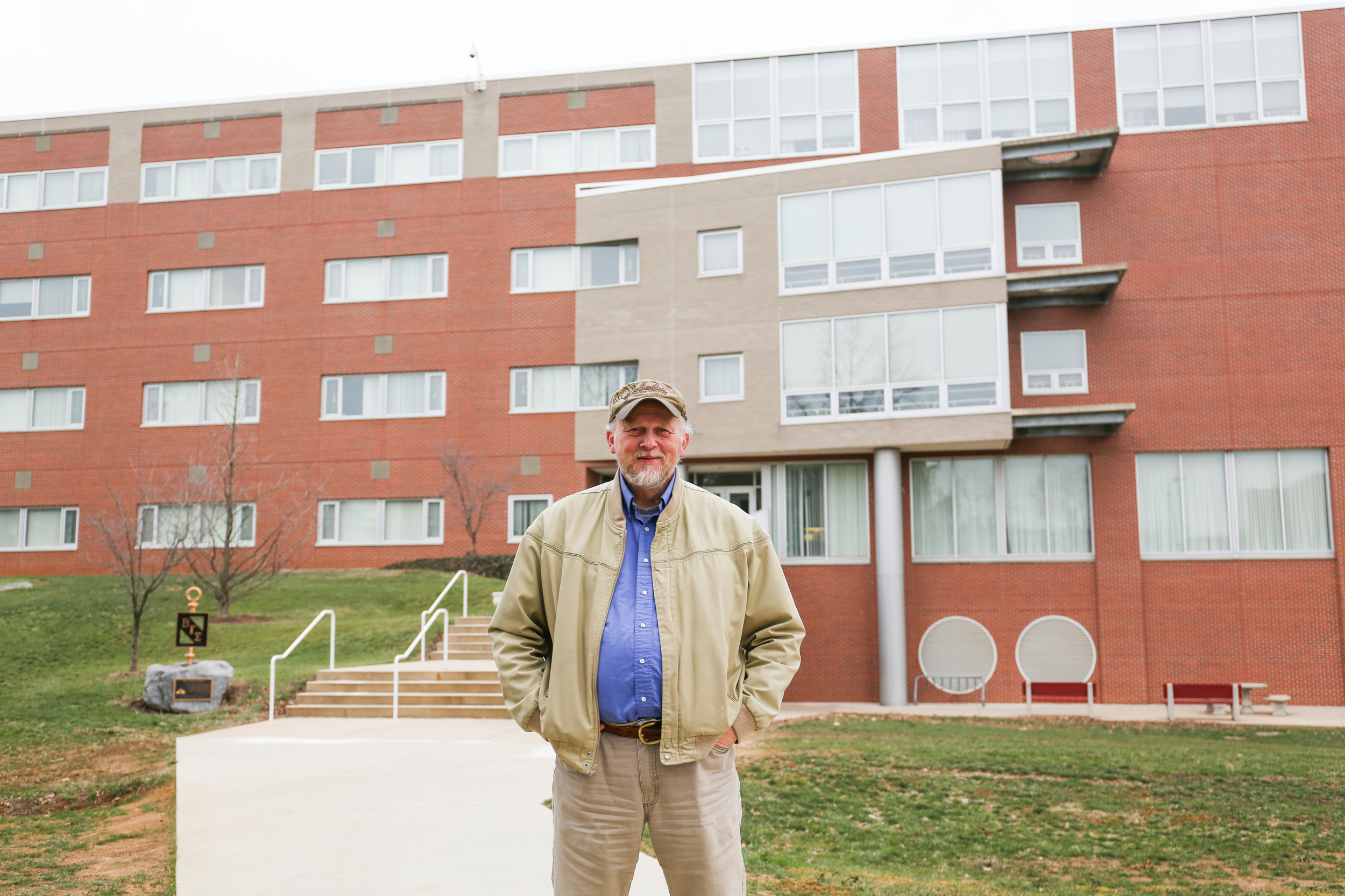 Mark Knight in front of the John L. Grove College of Business.