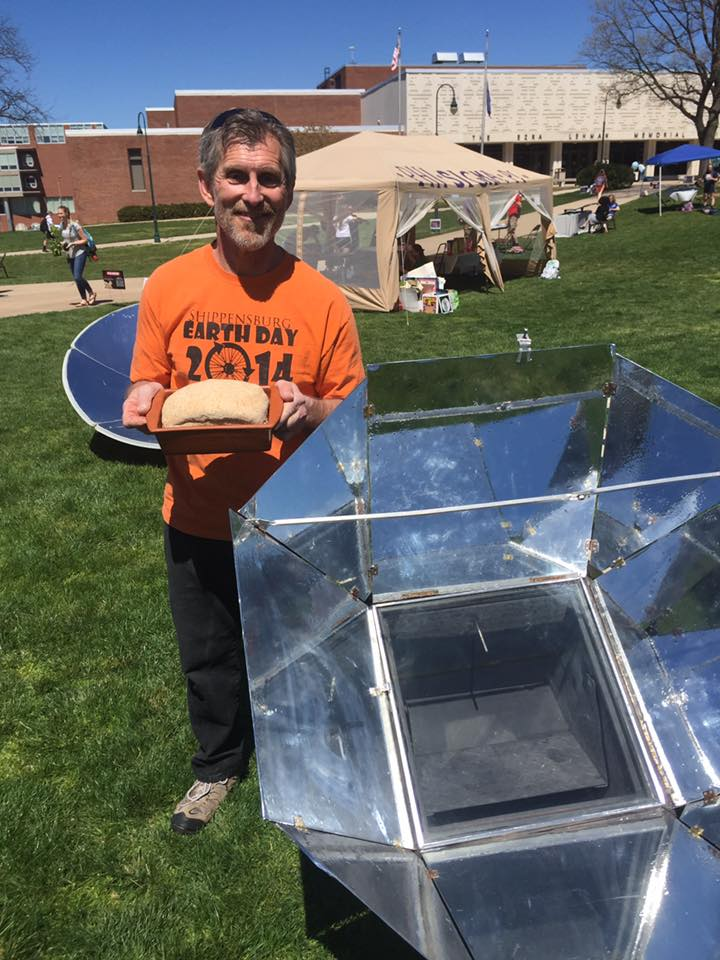 Ben Culbertson, assistant professor of art and design, bakes break with a solar cooker.
