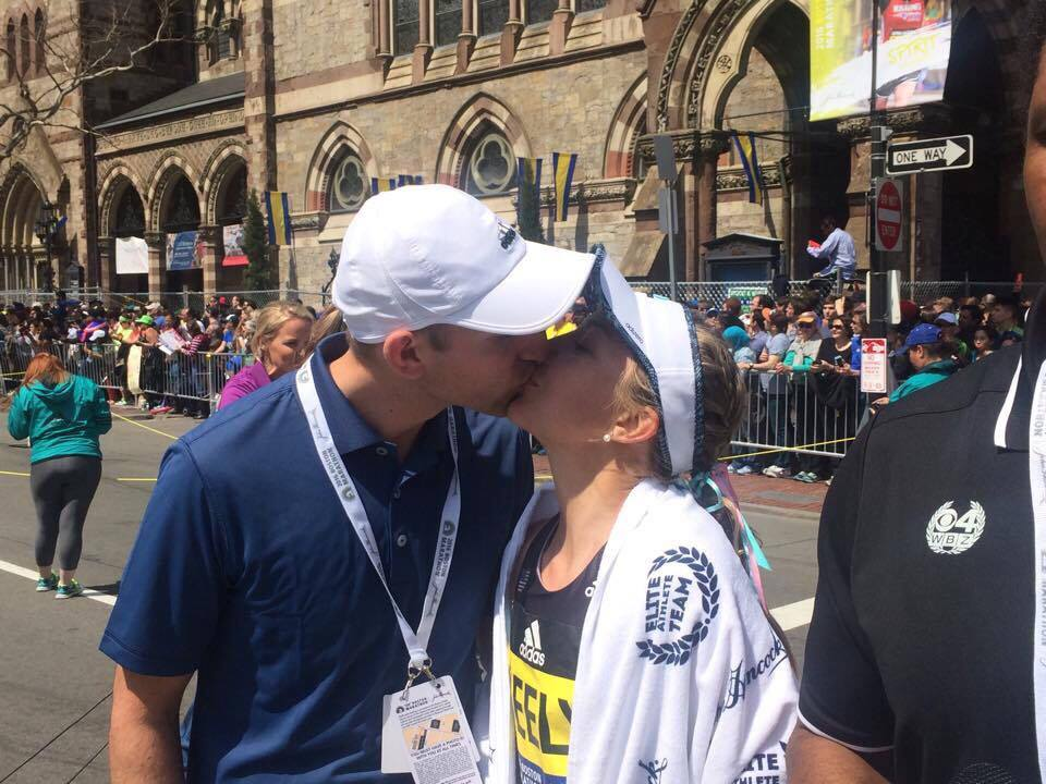 Celebrating her Boston Marathon finish with husband, Dillon Gracey, who is her coach and a fellow SU alum.