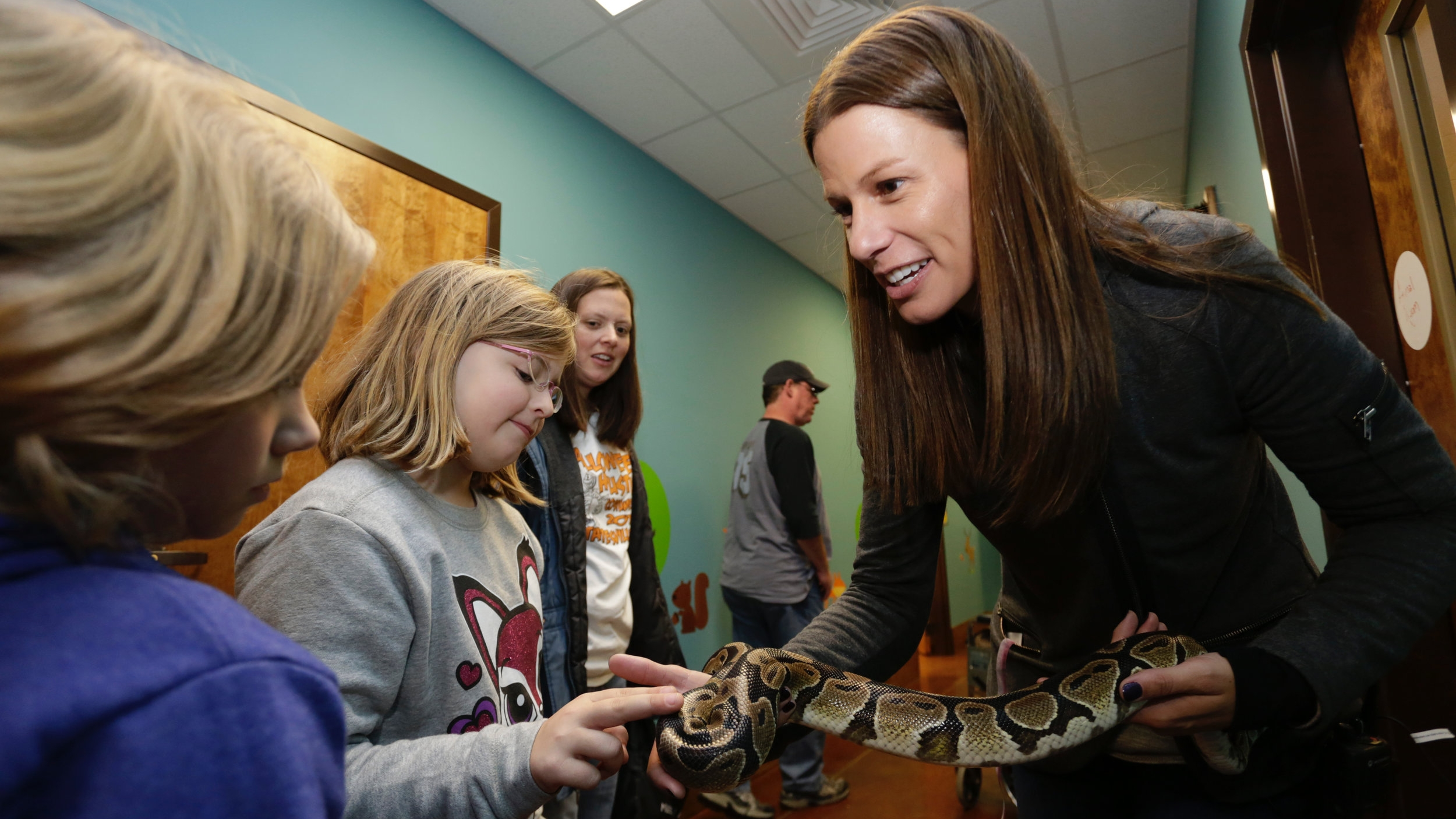 At Rescue Ranch, Krissie Newman '00 loves to see students' reactions in the snake room