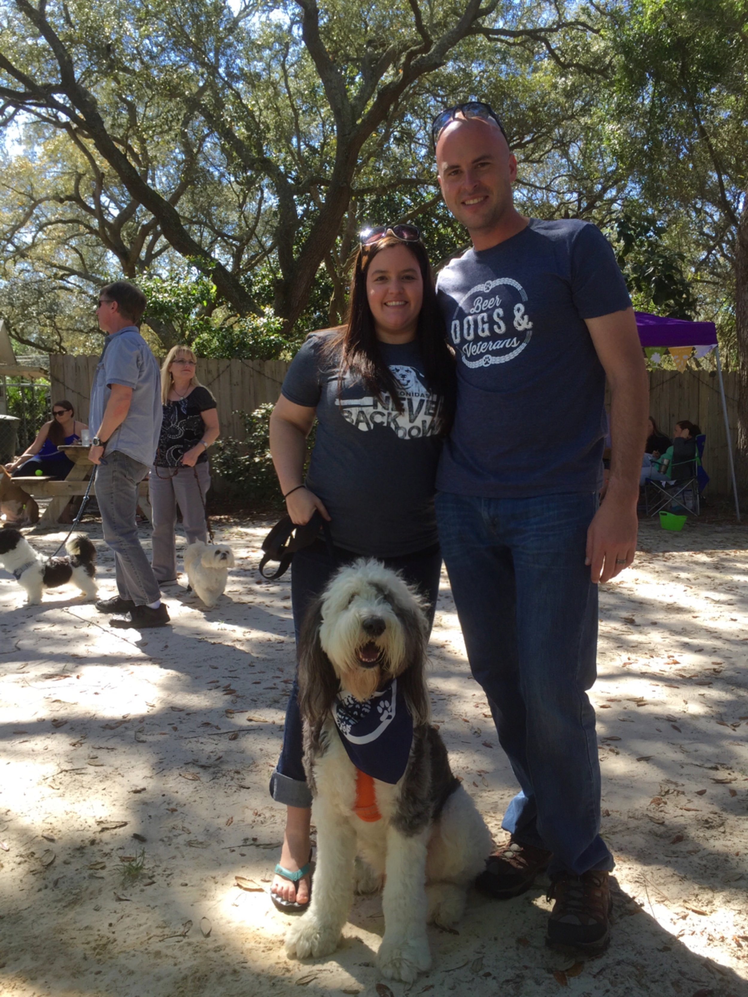 Allison Mercer '07, executive director for Dogs on Deployment, attending a fundraiser with husband, Joe, and their pup, Ted.