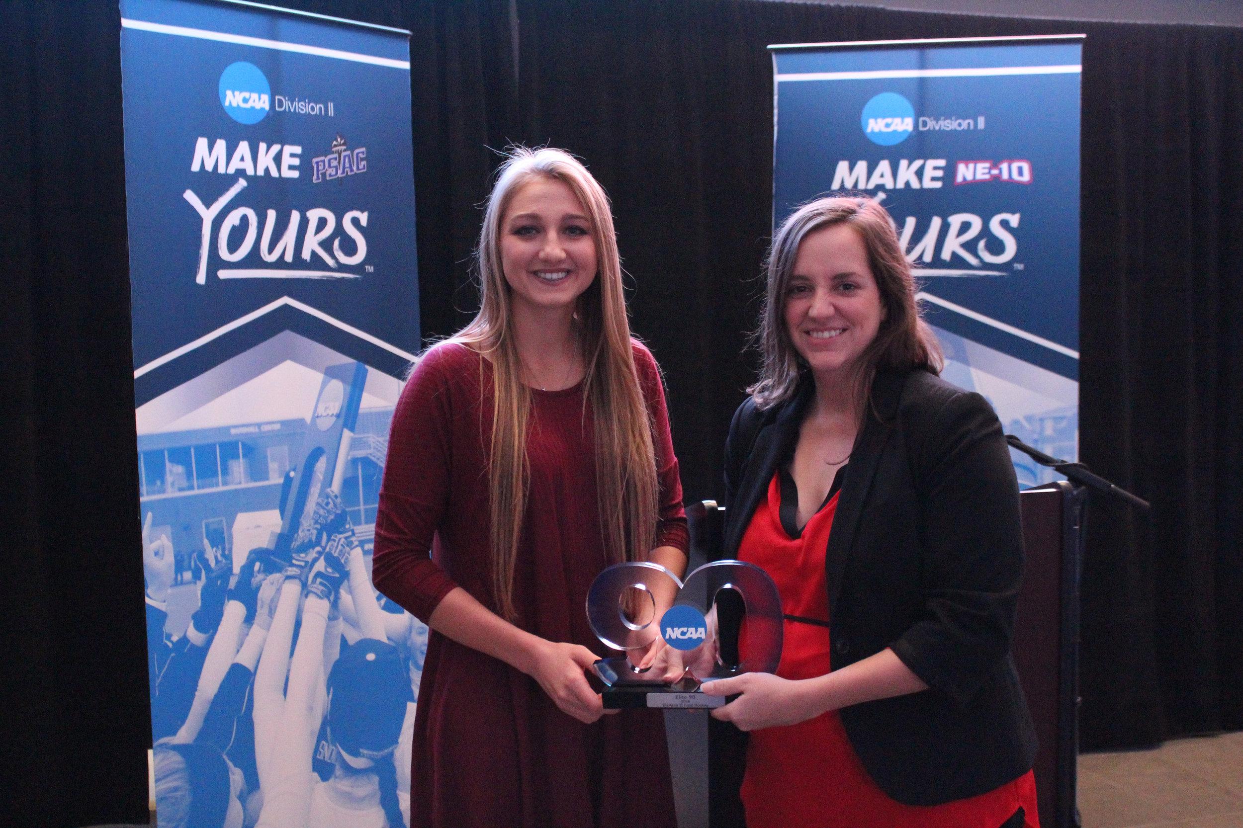 Junior Maddie Scarr (left) accepts her Elite 90 award.
