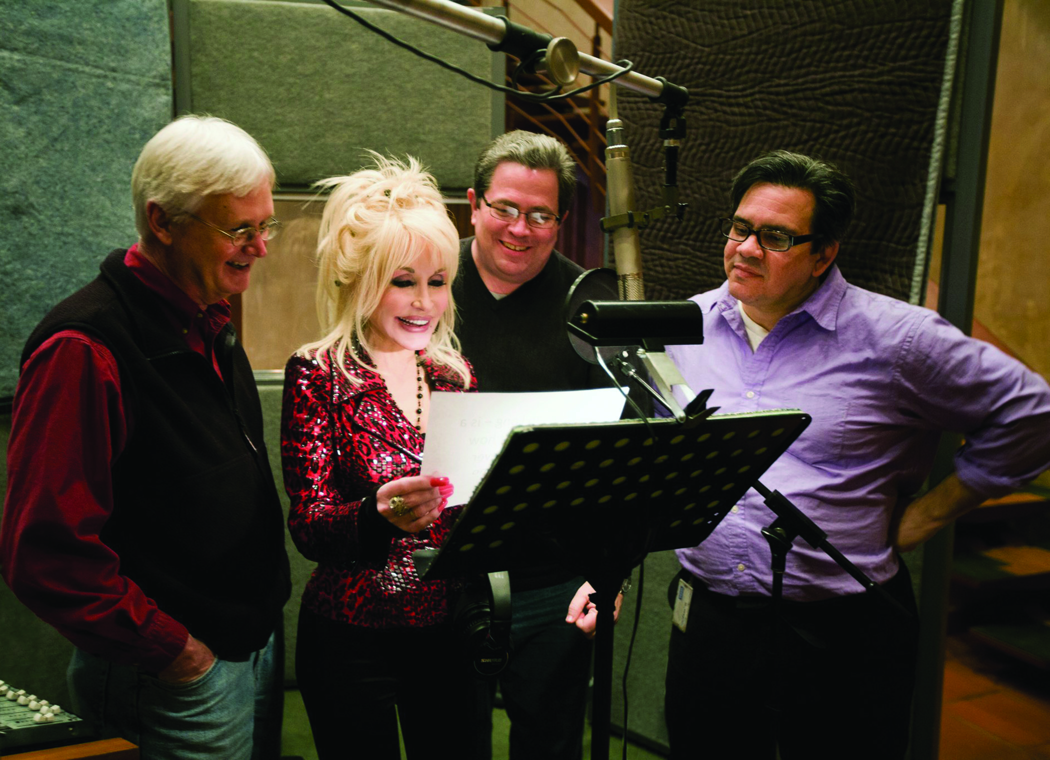 Pictured with Dolly Parton, Brian Hull '84 graduated from Ship as a theatre major and has made a career as an Emmy®-winning animator and puppeteer.