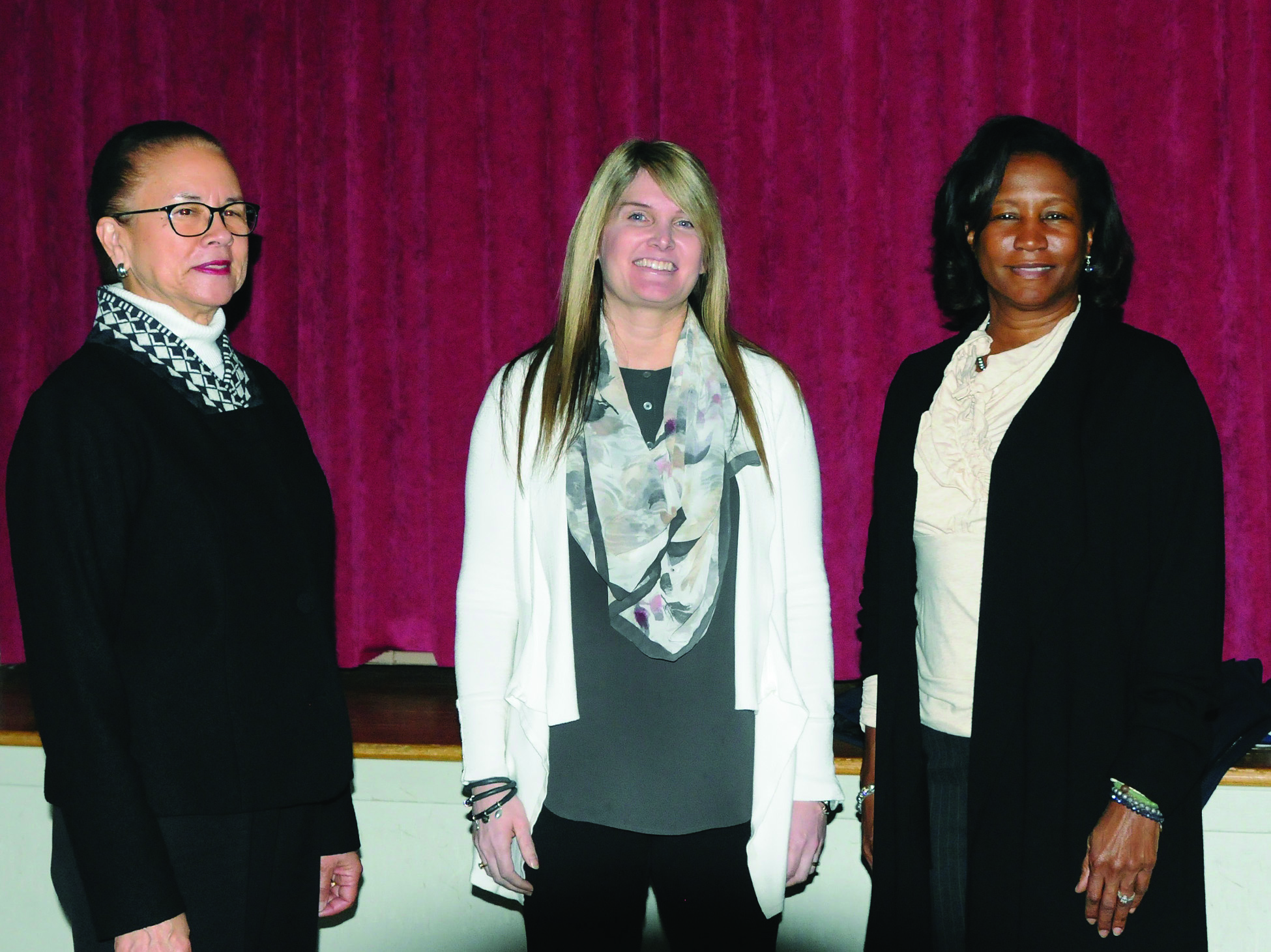 Jolinda Wilson (center), the first doctoral student to defend her dissertation at Shippensburg University, with Barbara Lyman (left), provost and executive vice president, and President Laurie Carter in February.