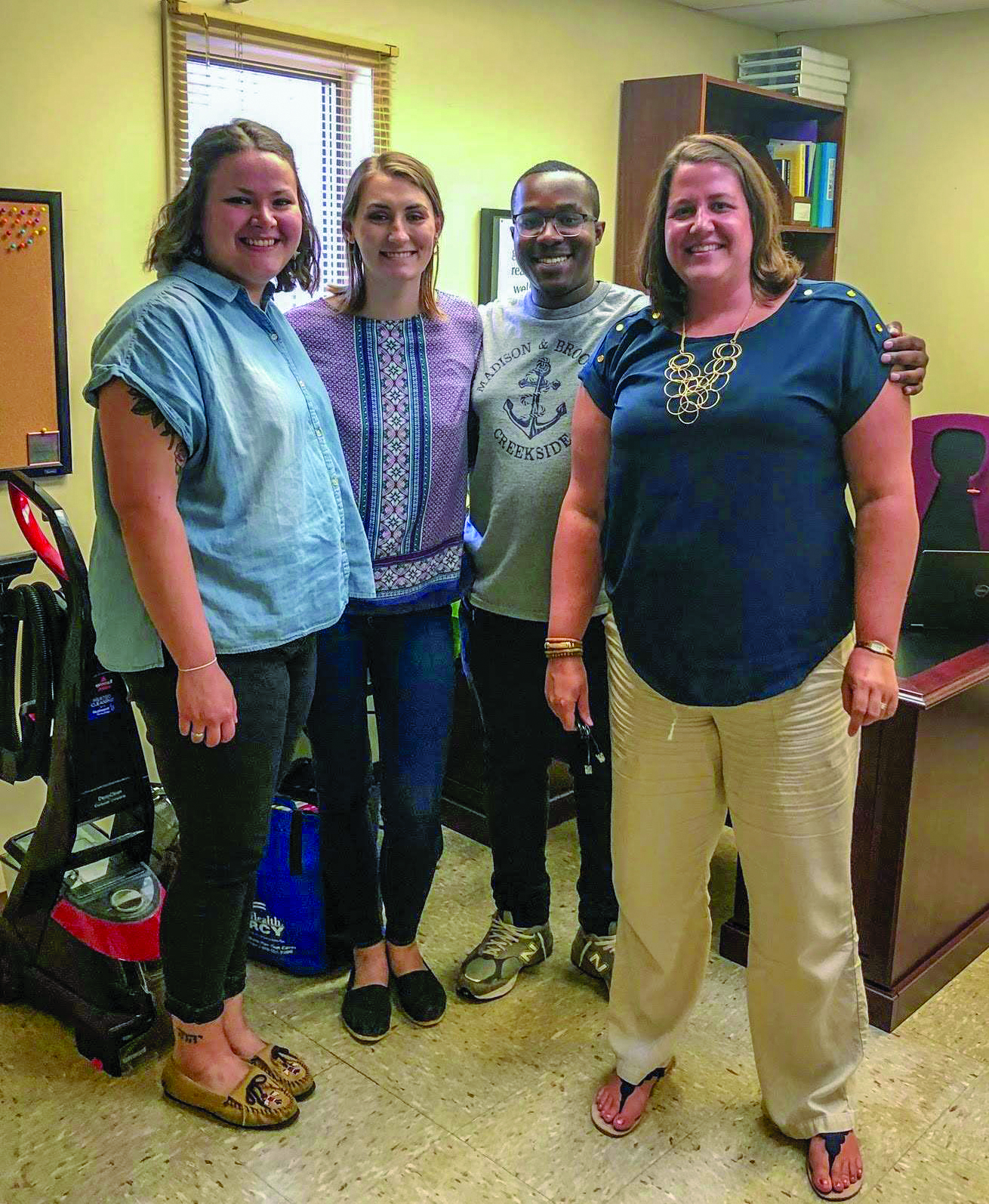 (From left) Interns Taylore Kerns, Emily Greene, and Shakir Alexander-Noah with Laura Masgalas '07-'11m, community mobilizer.