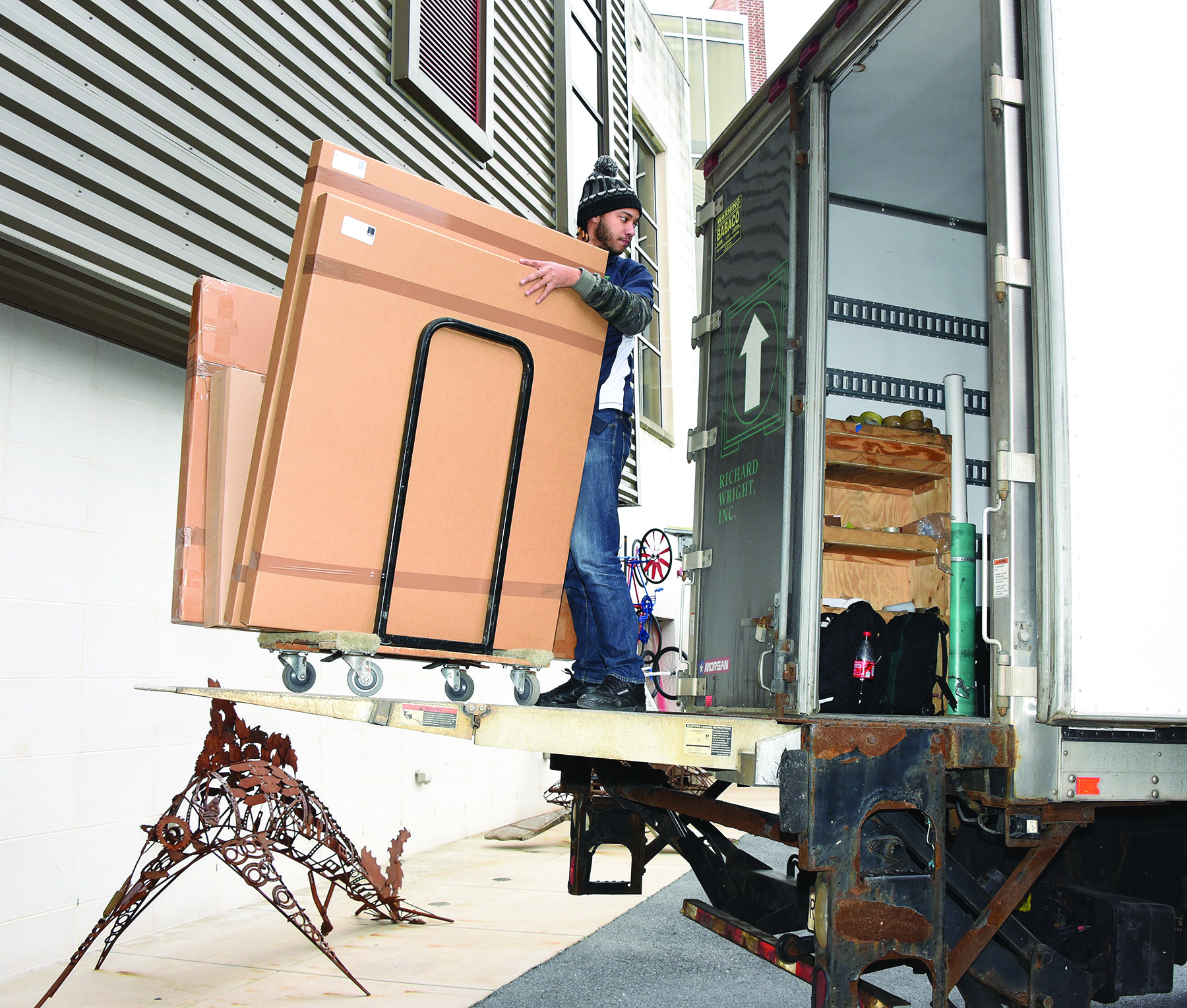 Crews unload artwork from New York City.