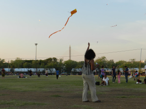"Flying a kite at the ""King's birthday carnival"""