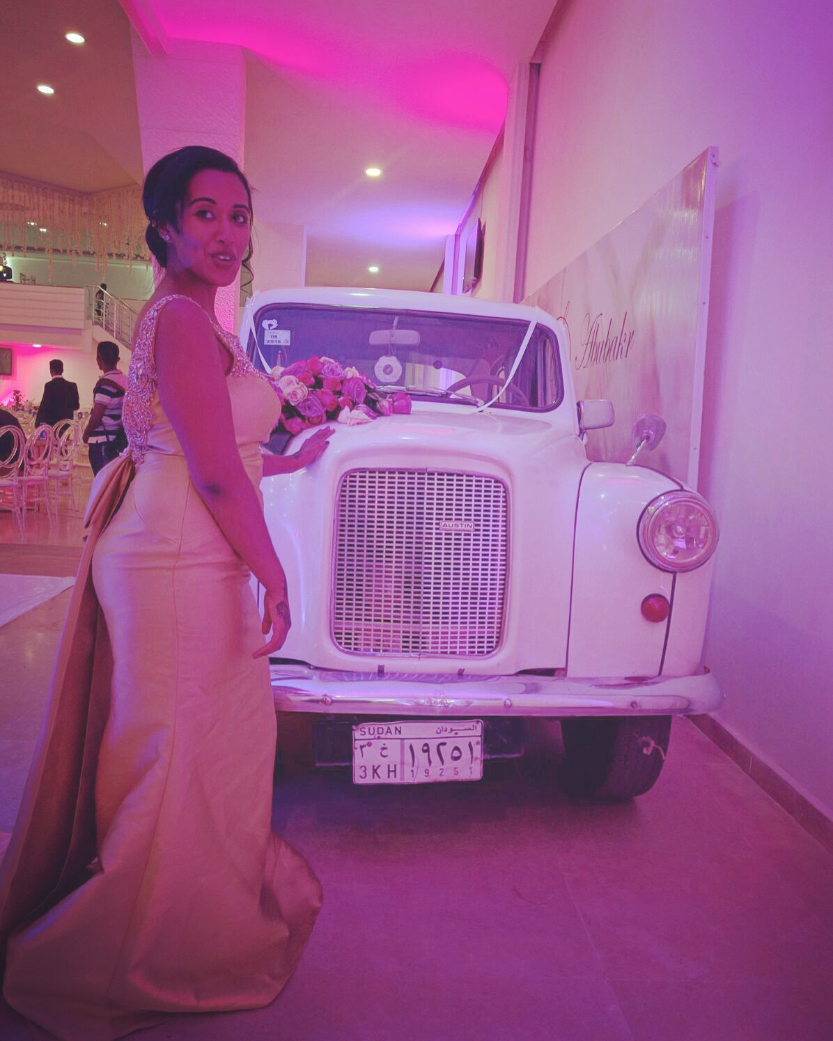 In my ball gown posing next to the vintage Rolls Royce. Shoutout cuzzo for providing the car, the pose, and the awkward smile!