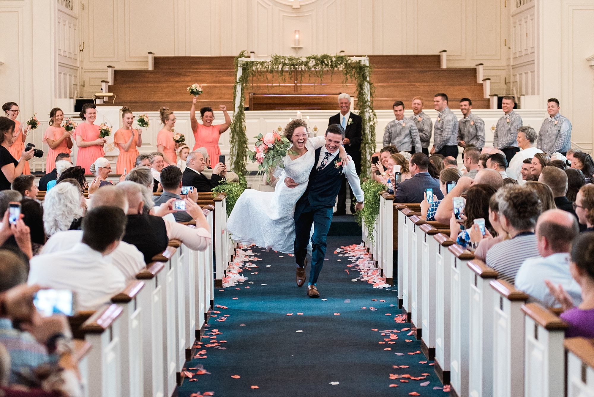 Yes, he picked her up and ran down the aisle with her!
