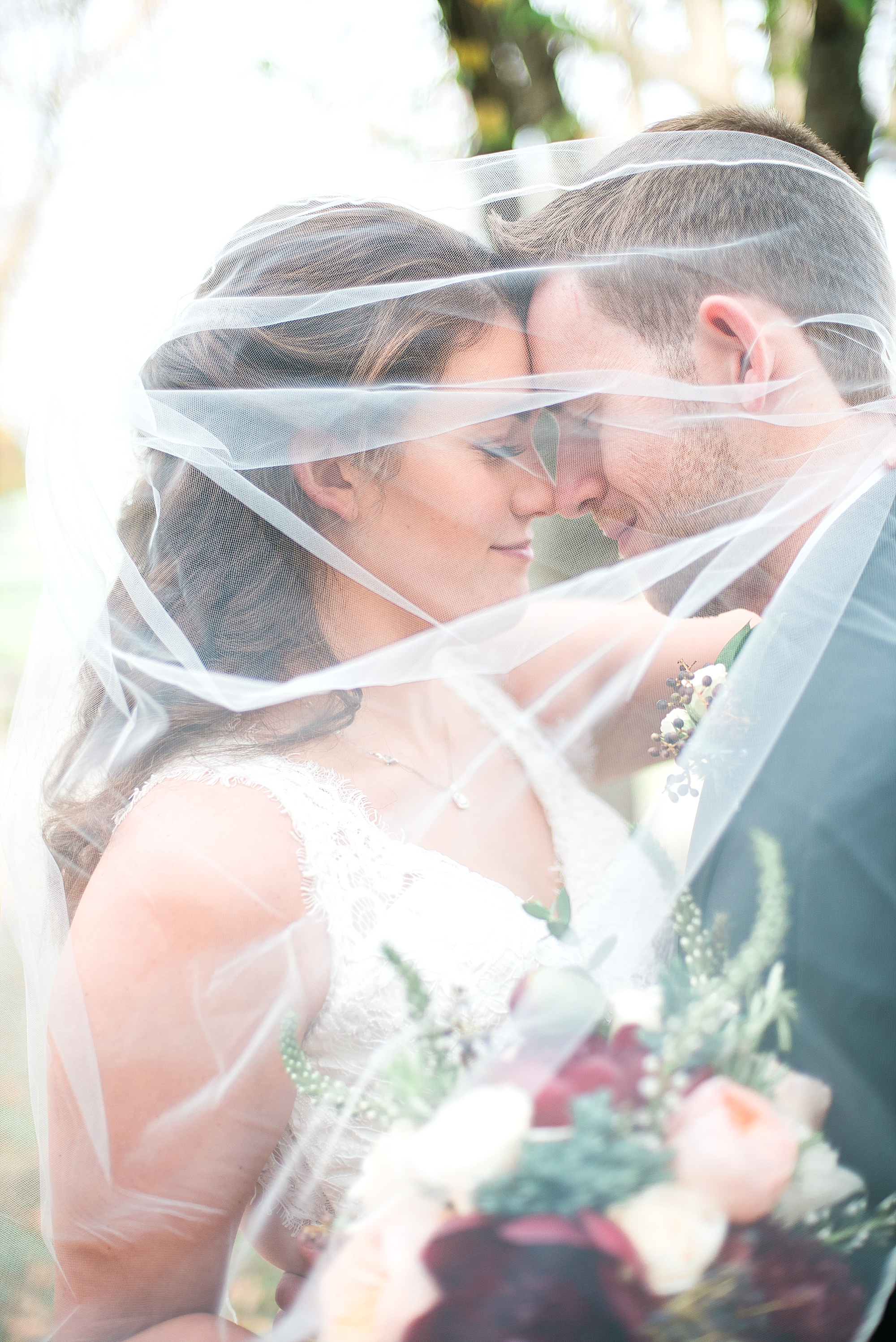 bride-groom-under-veil