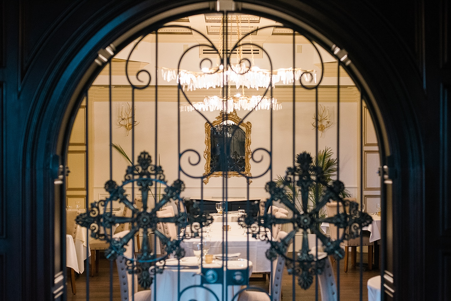 View into the dining room through the wrought iron doors.