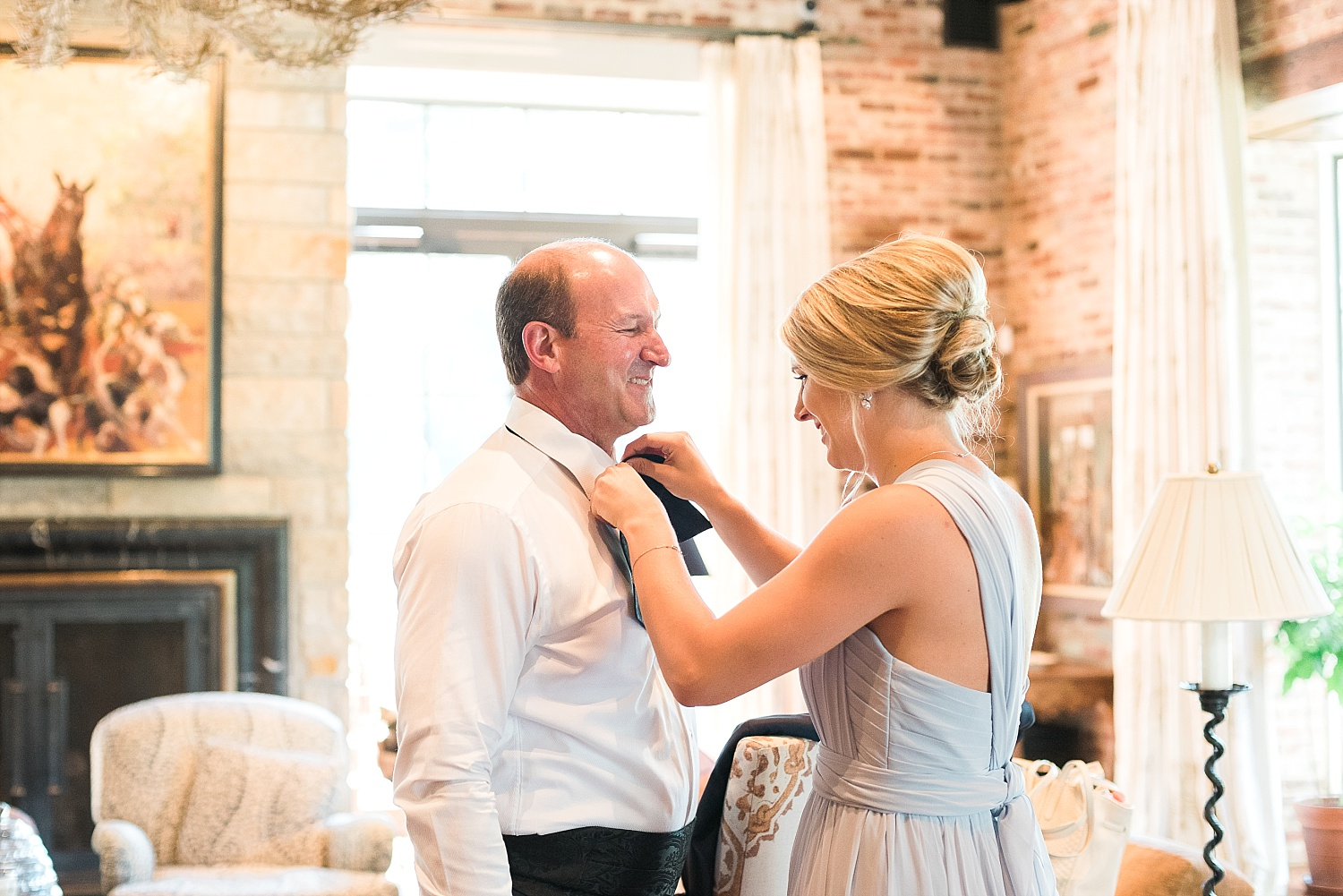Father of the bride getting all fixed up by a sister of the bride!