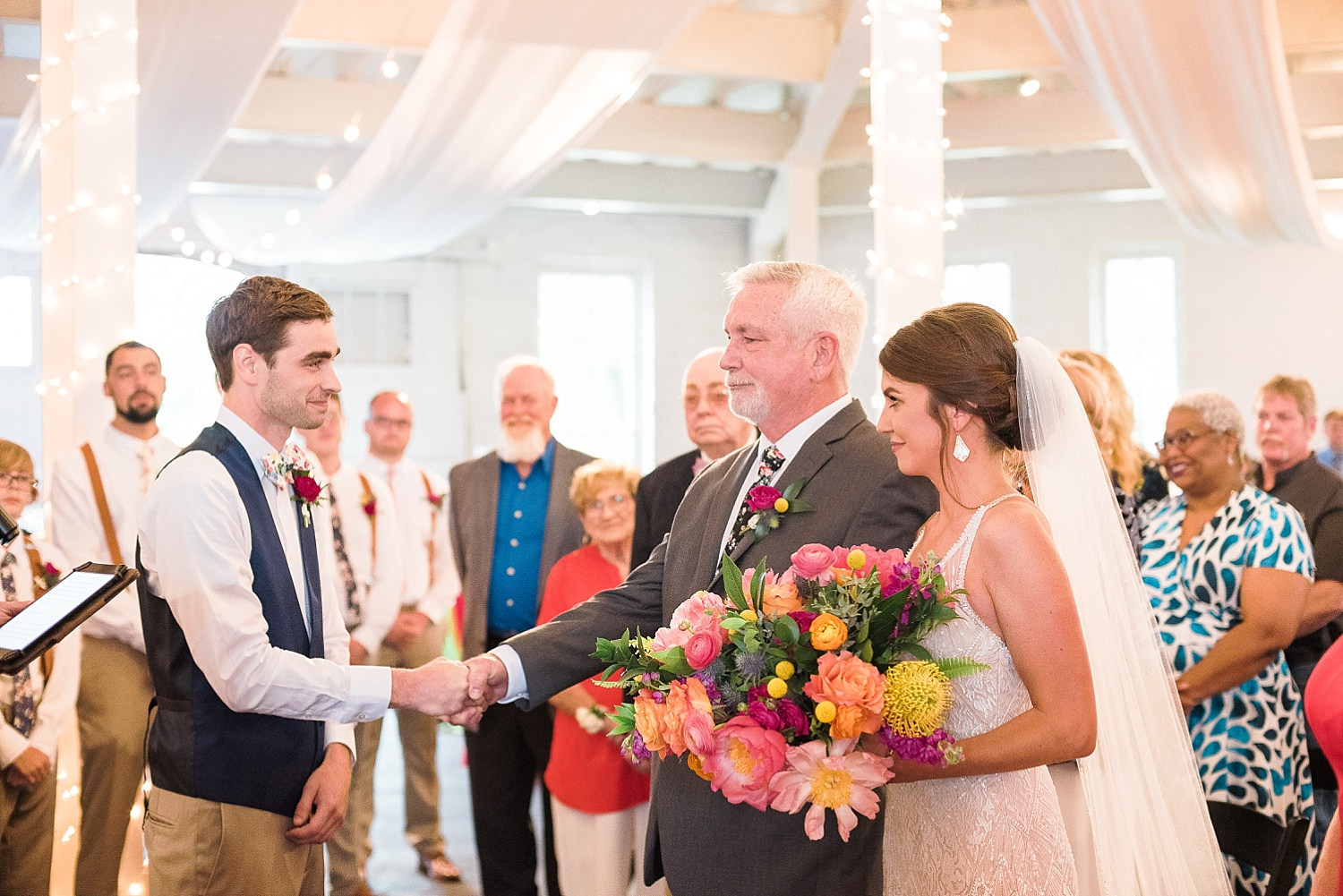 indoors-ceremony-at-round-barn
