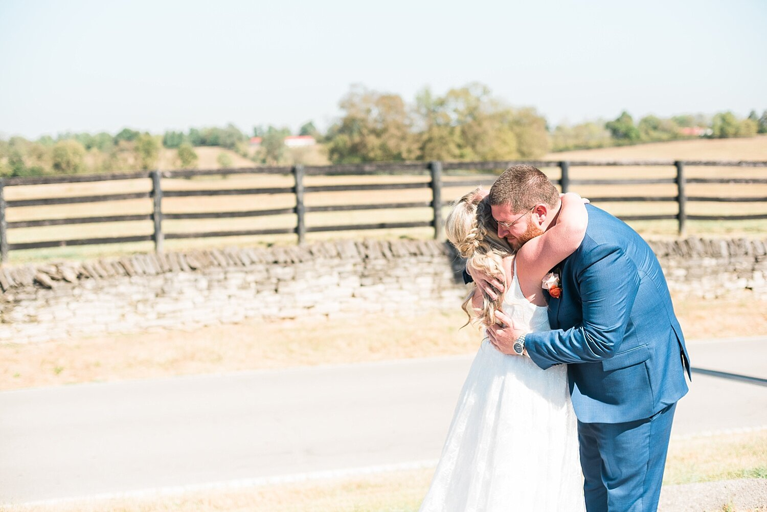 Amy and Reza had a sweet first look with the beautiful horse farms in the distance.