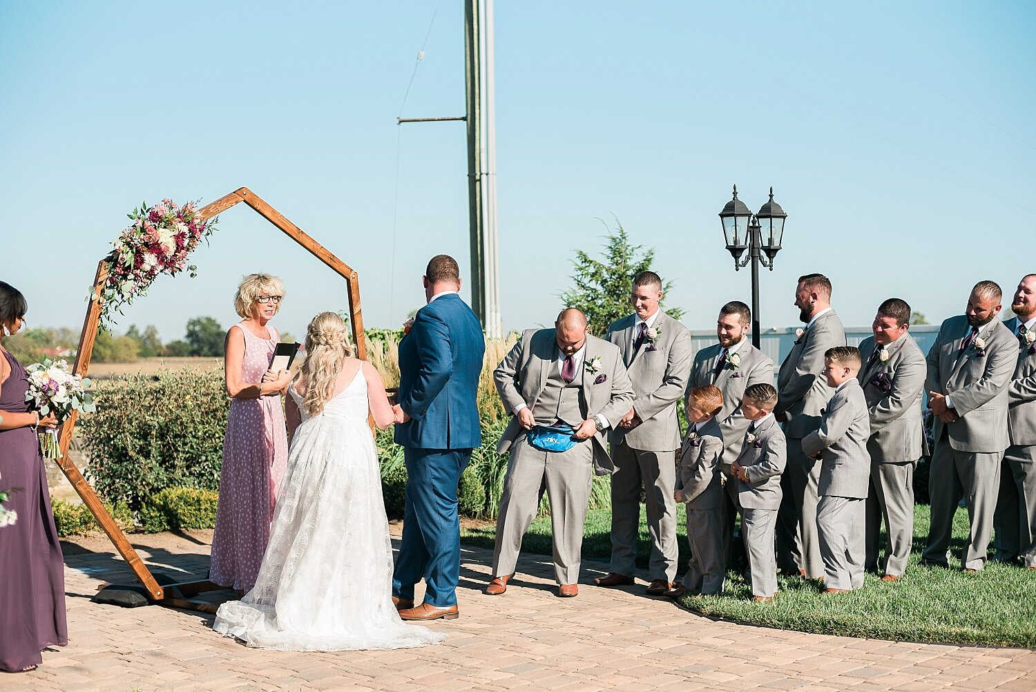 The best man made everyone laugh by carrying the rings in a fanny pack!