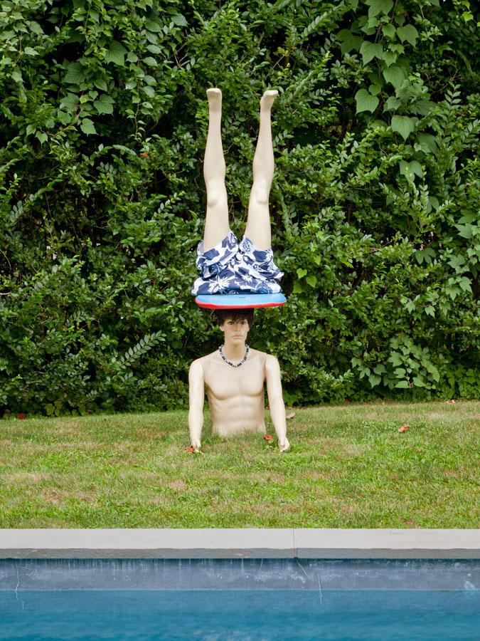 John Miller, Side Board , 2012,mannequin, synthetic wig, boogie board, swimsuit, puka beads, wooden dowel,88 x 20 x 36 in