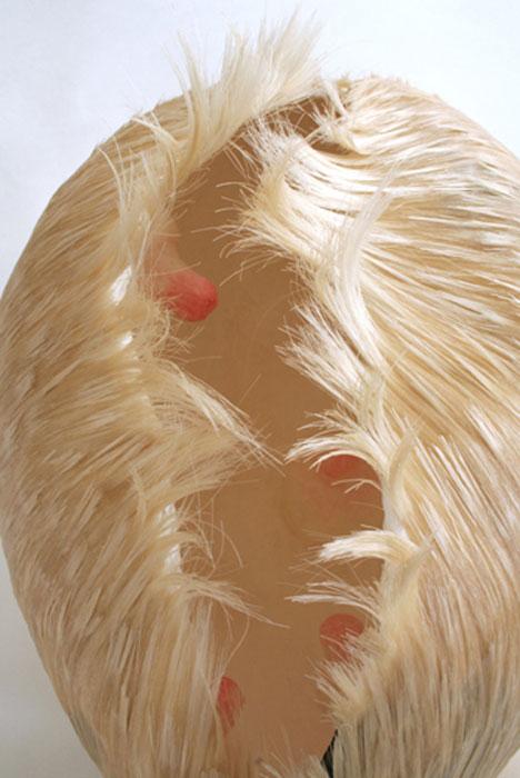 Jiyeon Park, Wink , 2011,paper mache, acrylic medium, artificial hair, 10 x 11 x 8 in