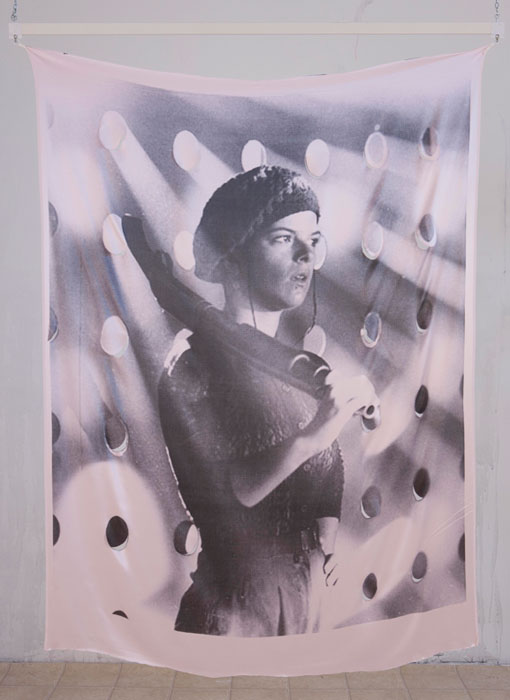 Servane Mary,  Untitled (Woman with Gun) , 2011, reversible pigment printed silk, 59 x 42.5 in