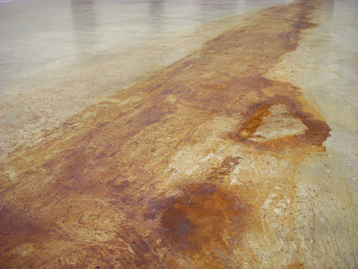 Daniel Turner, Untitled (iron oxide stain) , 2011, iron oxide stain on floor, dimensions variable