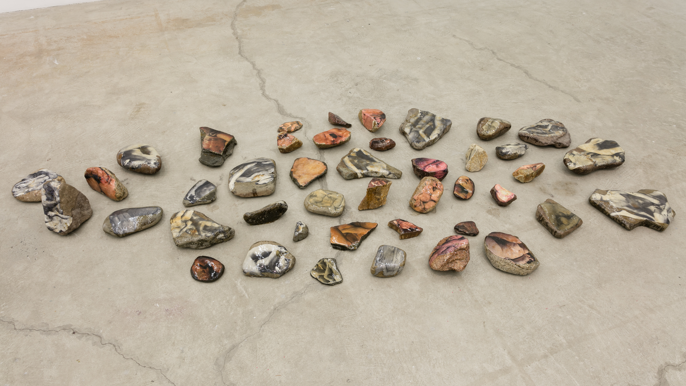 Aura Rosenberg, Dialectical Porn Rocks , 1989-2016, rocks, newspaper, xerox, resin, dimensions variable,Courtesy the Artist and Martos Gallery, New York