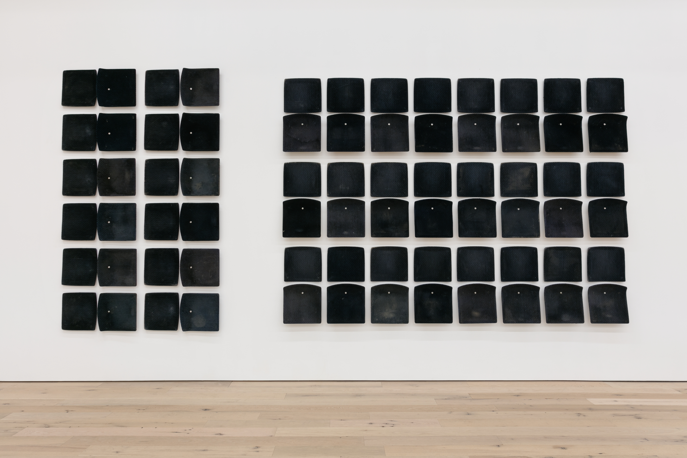Jessica Vaughn, After Willis (rubbed, used and moved) #005 , 2017, 36 individual pairs of used machine fabricated public transit train seats (Chicago Transit Authority 1998-2011), 98 x 225 x 0.25 in.