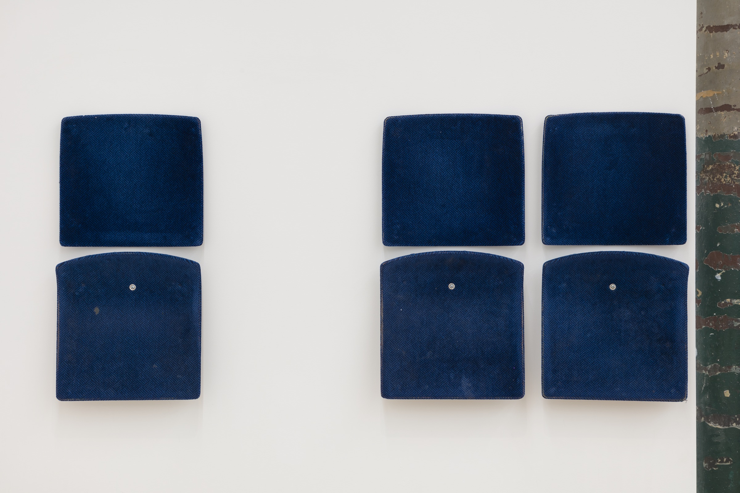 Jessica Vaughn, After Willis (rubbed, used and moved) #008  (detail), 2017, 7 individual pairs of used machine fabricated public transit train seats (Chicago Transit Authority 1998 - 2011), 284 × 32 in.