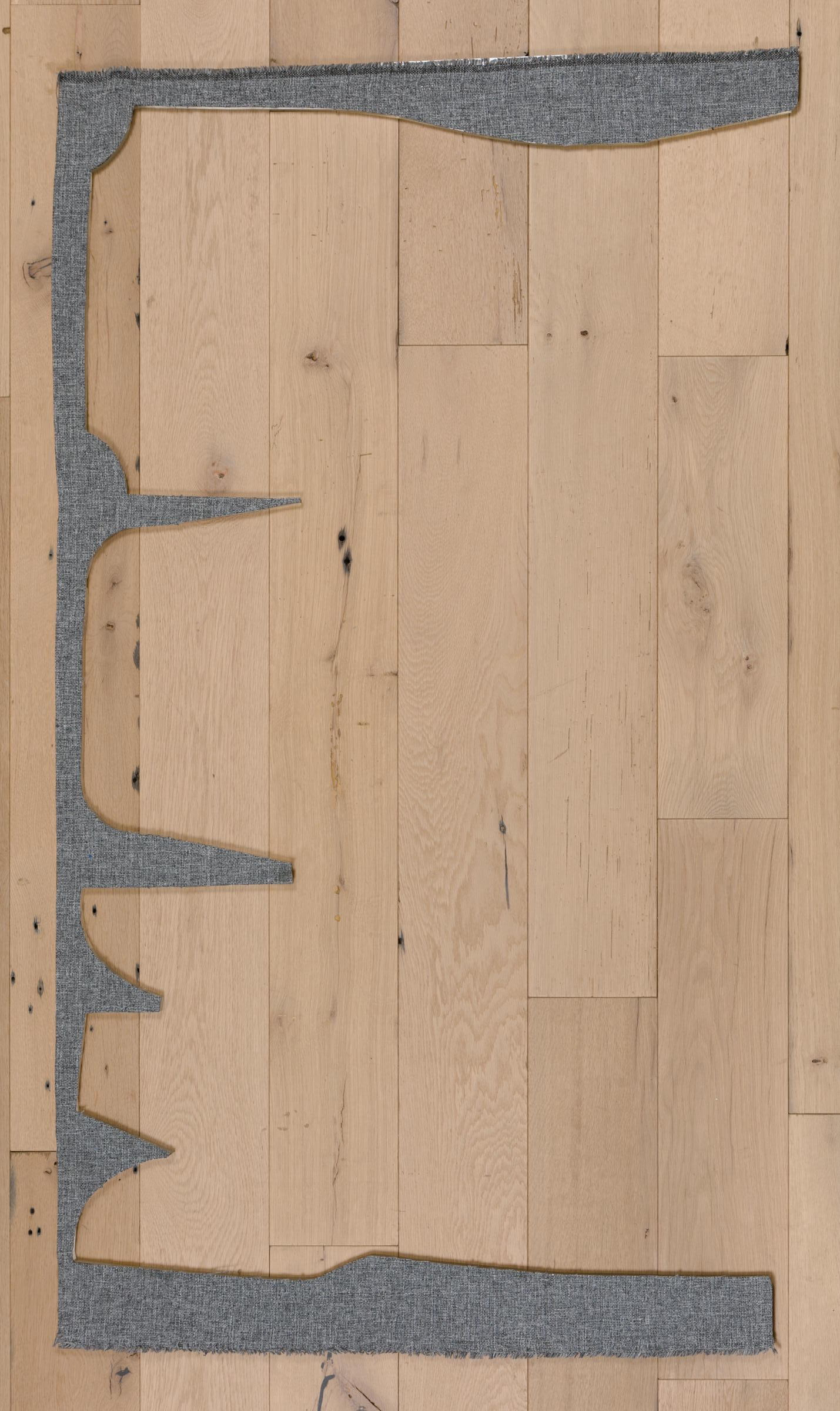 Jessica Vaughn,   Pacific Grey No. 48306 , 2017, fabric scraps procured from manufacturer (09/2015-11/2016) on plexi, 33 × 59 × ½ in.
