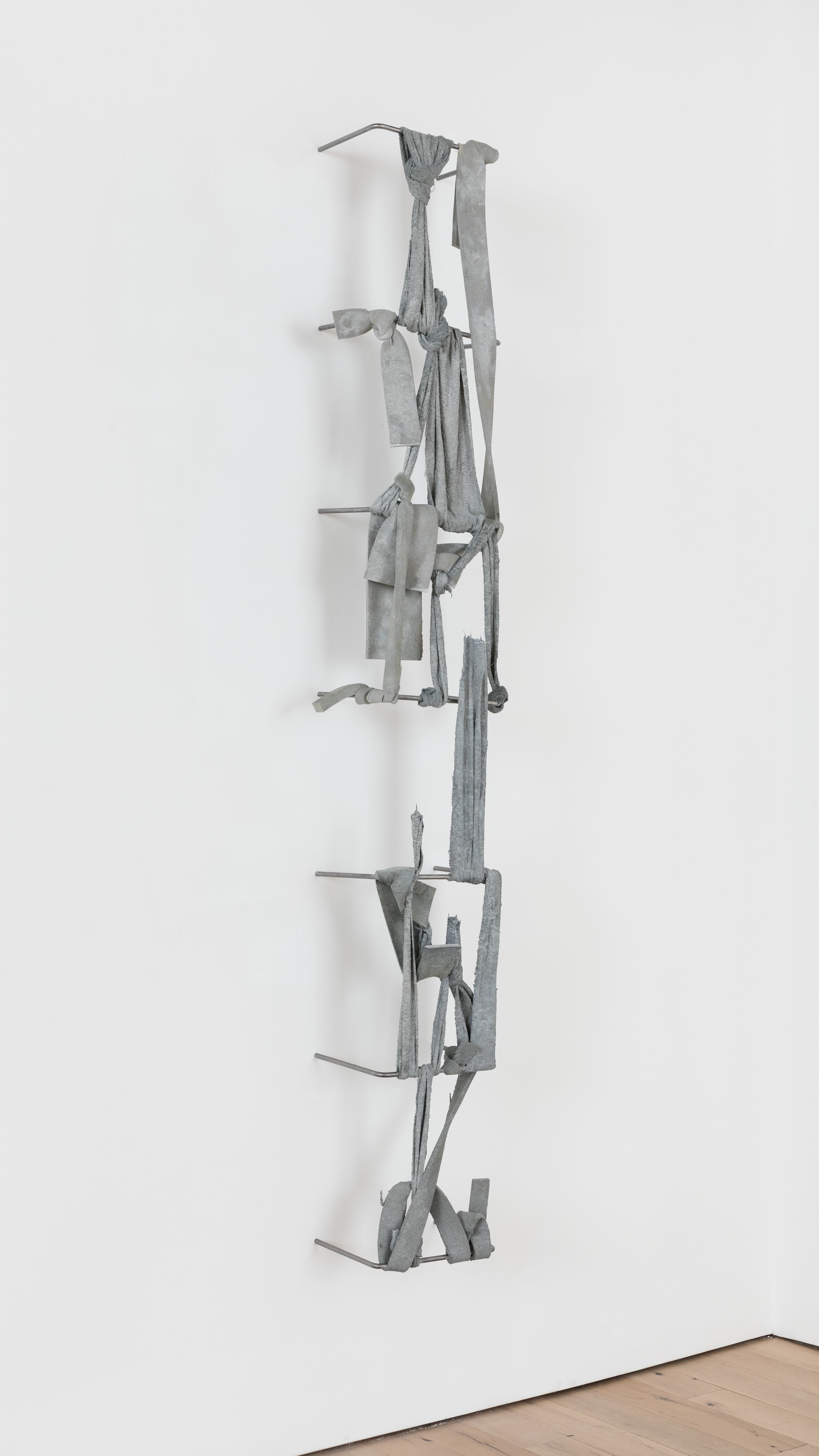 Nikita Gale,  FIXED LOOP I-II , 2018, concrete, polyurethane foam, terrycloth, steel, 115 × 21 3/4 × 13 1/4 in.