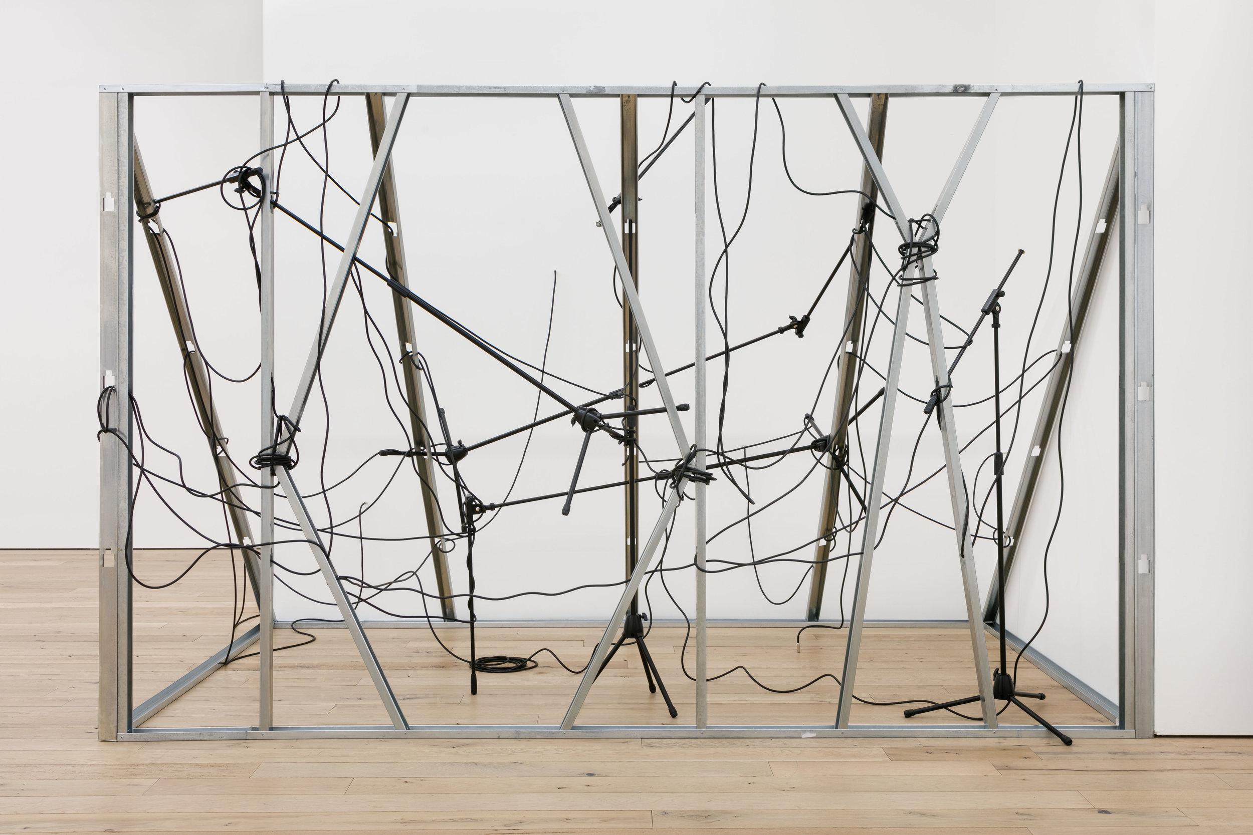 Nikita Gale,  INTERCEPTOR , 2019, mic stands, cables, metal studs, 85 x 138 x 89 in.