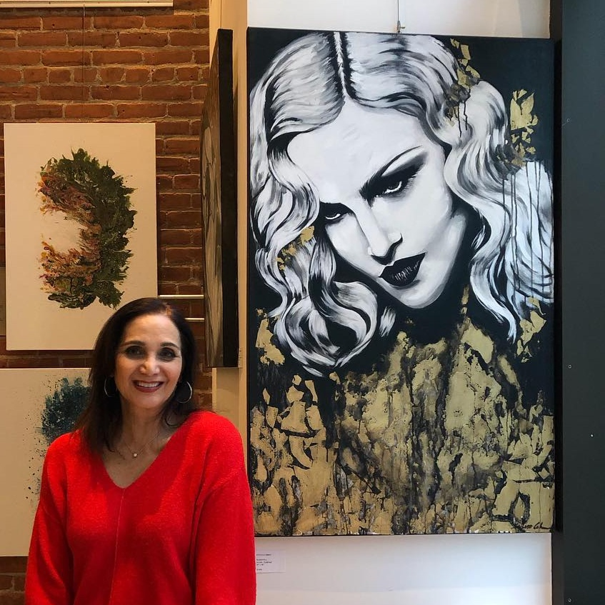 With one of the large artworks on display