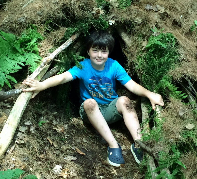 one of the proud engineers of a wilderness shelter at summer camp 2015.