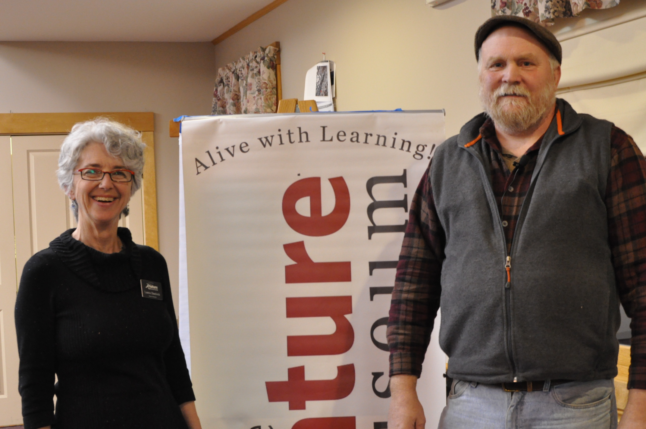 Board President Laurie Danforth and Michael Phillips at the Friday night talk