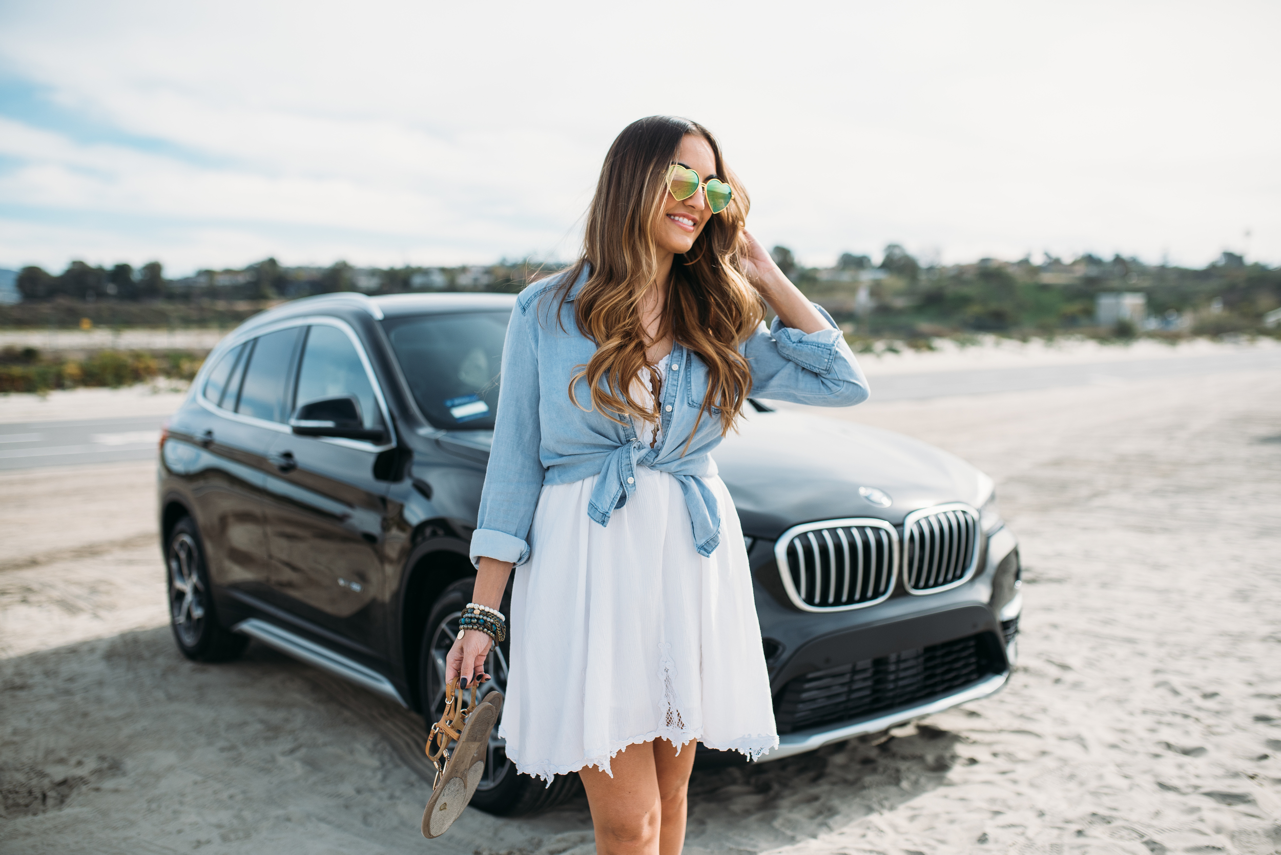 Olia and her new BMW.