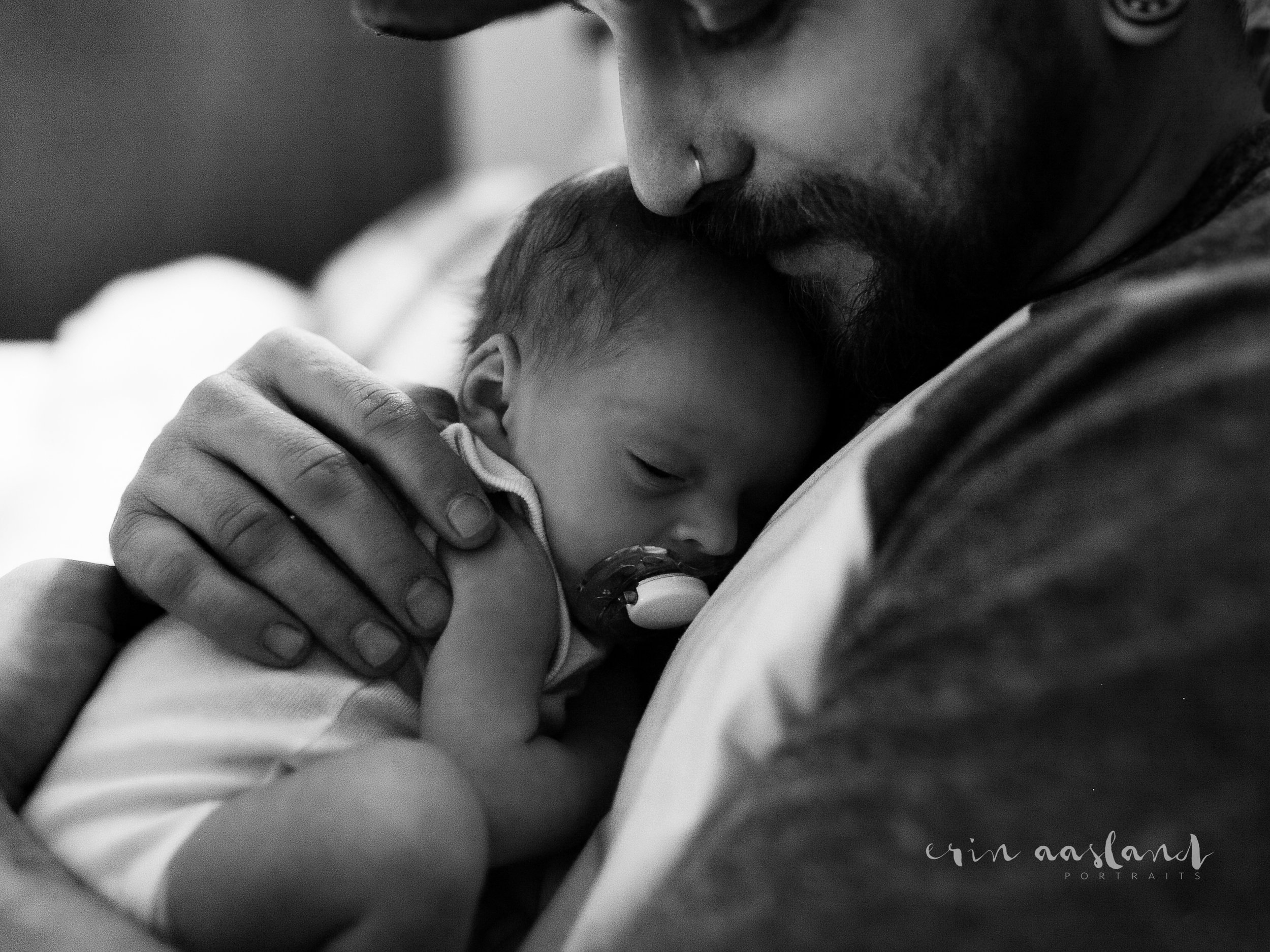 Erin Aasland Snoqualmie Newborn Photographer Home Session tender moment with daddy holding newborn