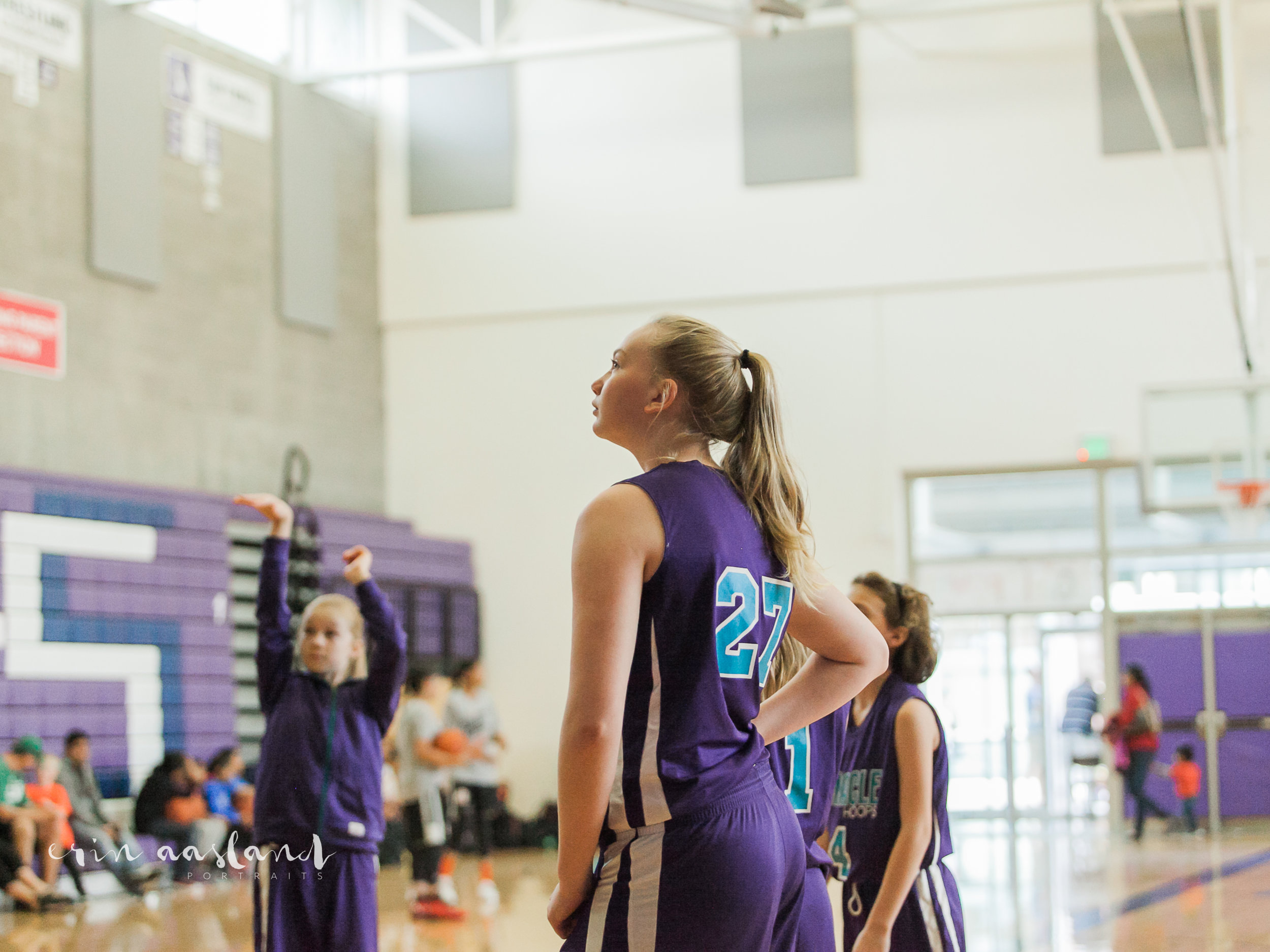 I have so many action shots of her, but this is one of my favorites... the lighting, the profile, the whole moment of it... it's my tough girl at her favorite place, the court.