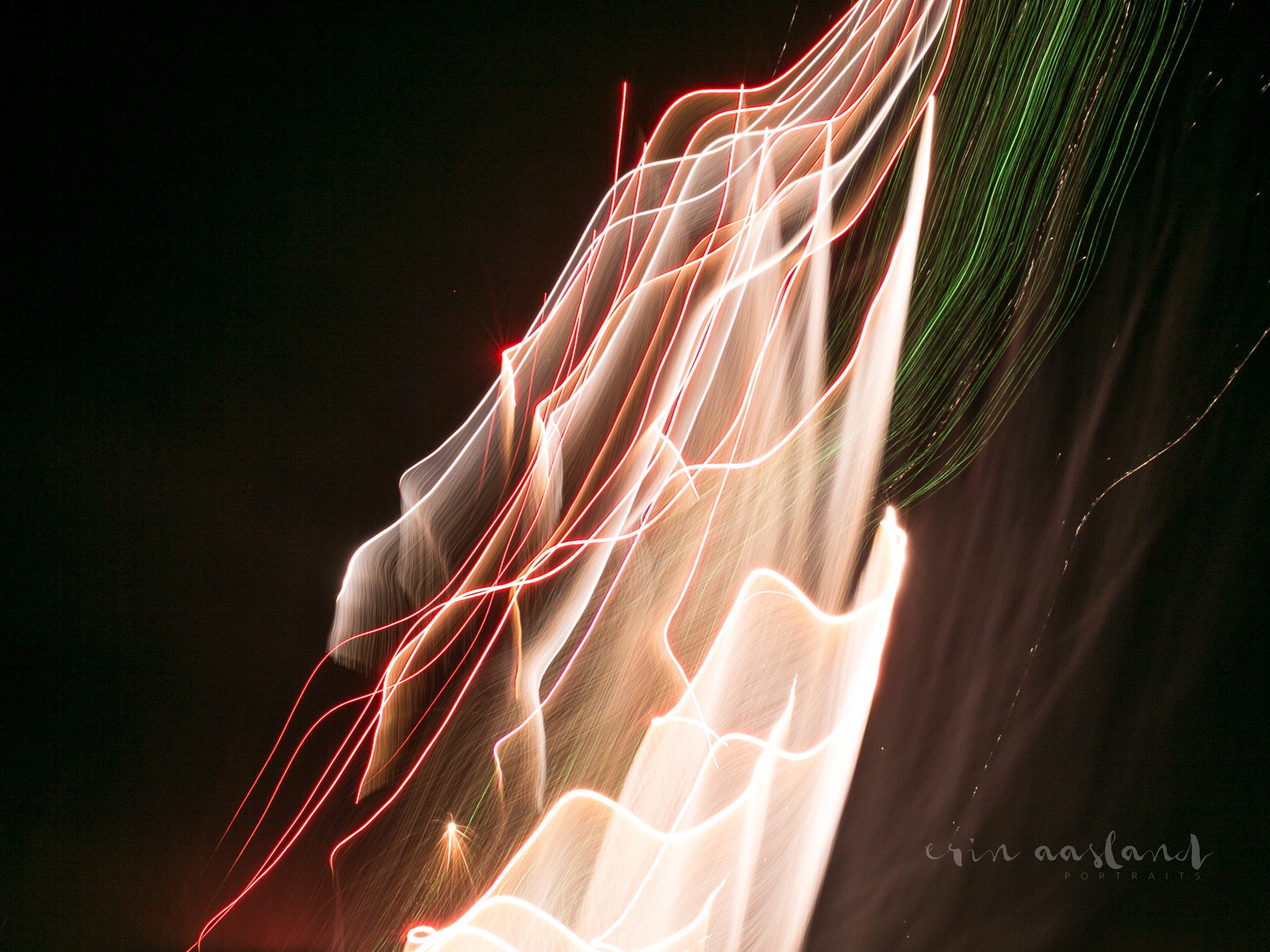 Erin Aasland Snoqualmie Photographer Fireworks white trails with green